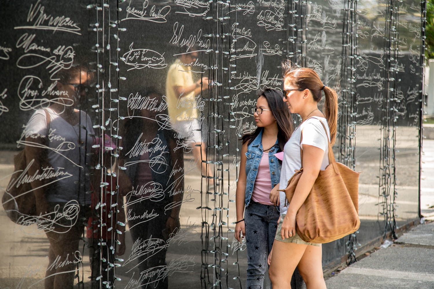A portion of the marble walls outside Aguinaldo's home. Written on it is the the Act of Proclamation of Independence of the Filipino People in Spanish and English, together with the signatures of prominent cabinet members during that time.