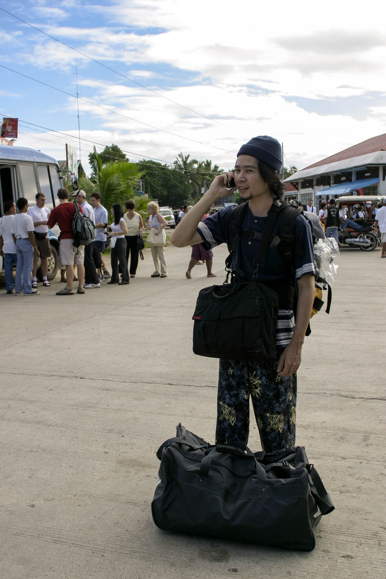 2003, Caticlan Airport. The husband trying to figure out how to get to our resort because his contact forgot to have us picked up. Google Maps, Siri, etc. weren't a thing back then, but thank God for mobile phones!