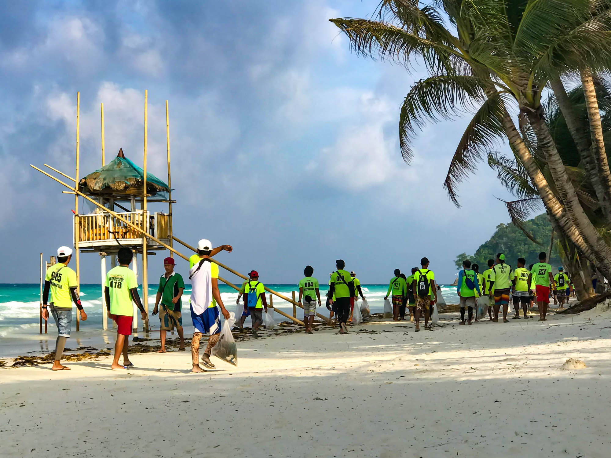 2019, White Beach Station 1. I was having my morning coffee when I saw these instructors on their way to work picking up trash.