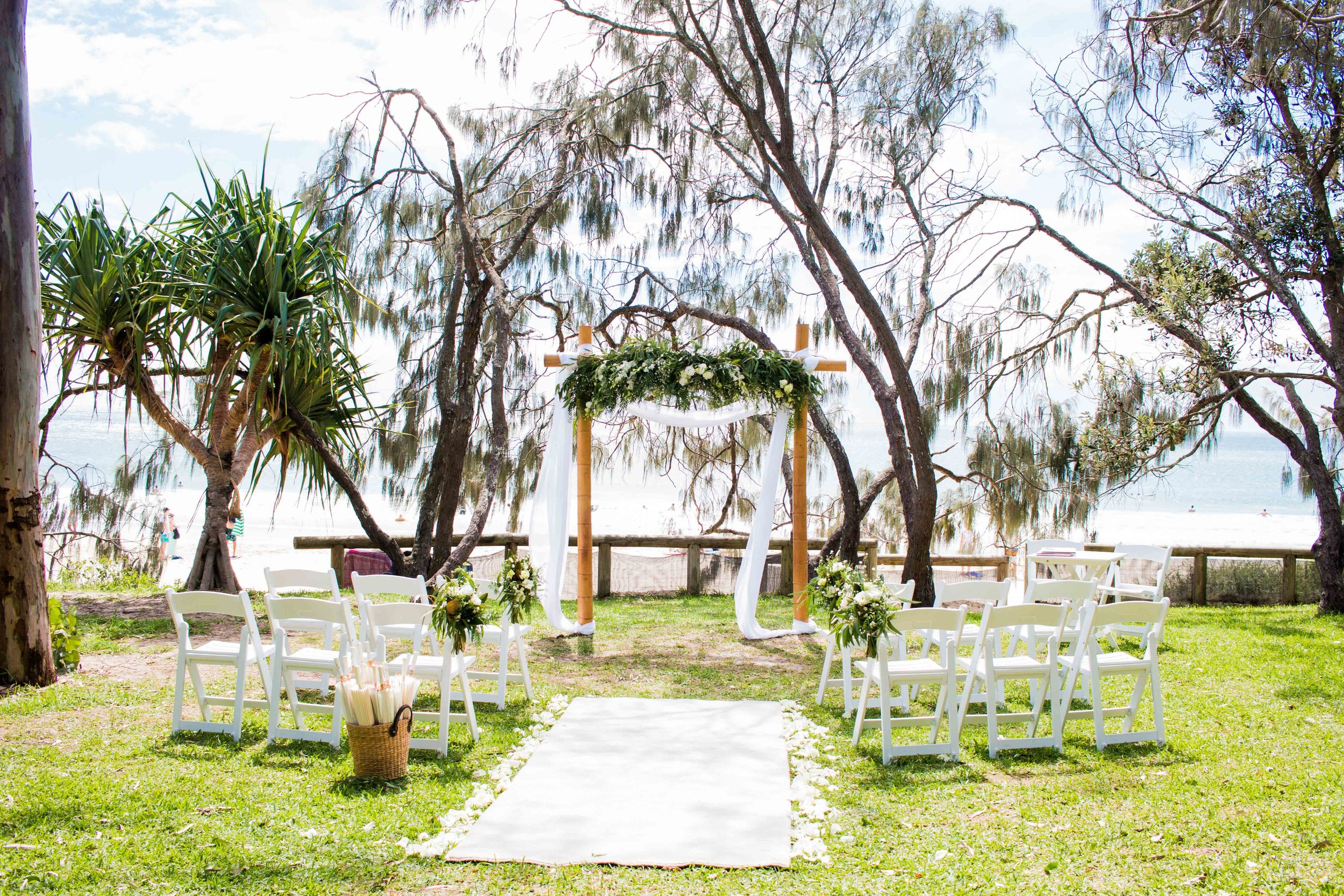 Hidden Grove ~ Noosa Foreshore. Celebrant and Styling Package which includes the above styling décor scene (white and green florals) = $2,320 total cost inclusive of delivery, set up and pack down. Your choice of seasonal flowers which are yours to keep after the ceremony service. Please visit 'Natalie Skye Celebrant' Instagram page for more styling décor inspo.
