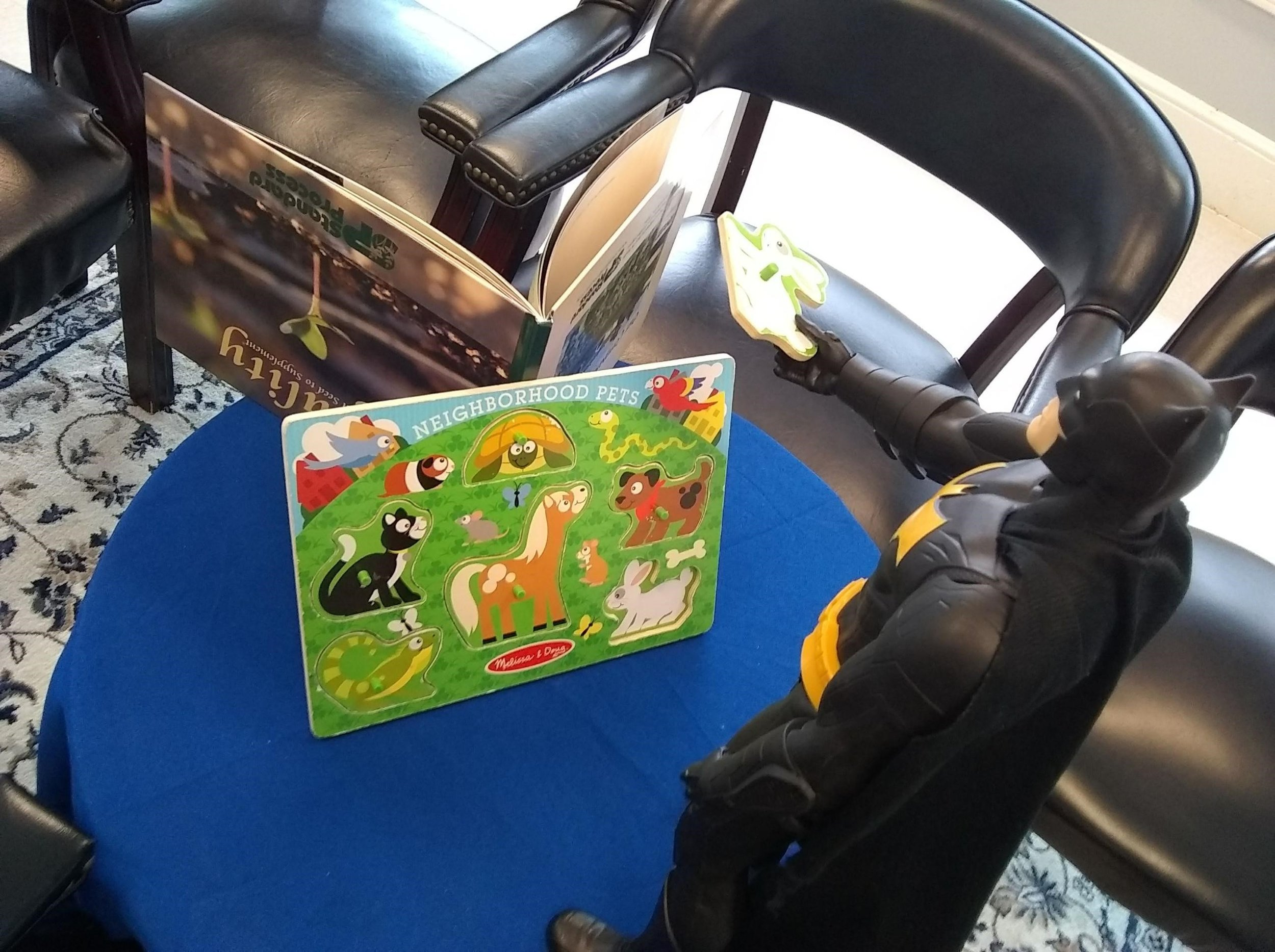 Batmen helping one of our younger patients with a puzzle....