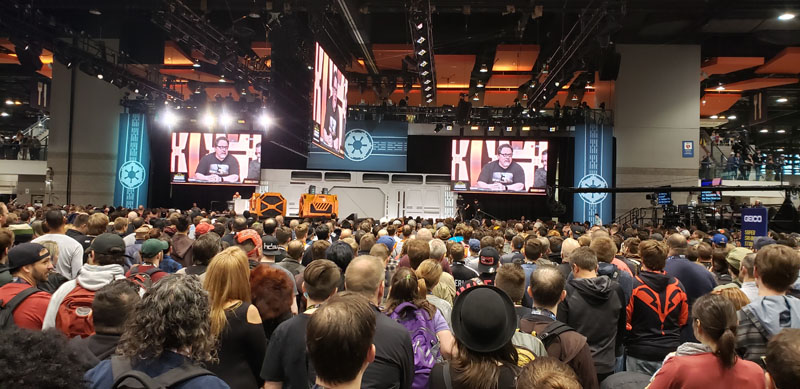 The dealer room stops to watch The Mandalorian panel.