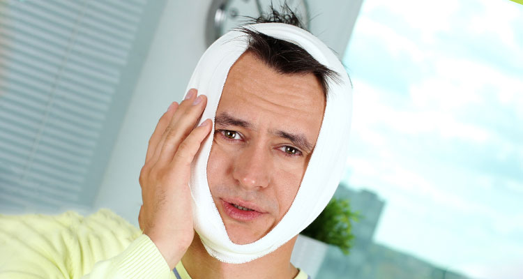 man-with-tooth-pain-from-swelling.jpg