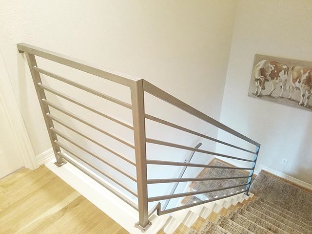 Modern painted steel horizontal railing. This #remodel really elevated the #staircase and tone of the home. It's amazing what an addition like a #contemporary railing can do! 👌 Curious what a facelift will look like for your stair? Give us a call, email or DM and let's find out! #stairboss