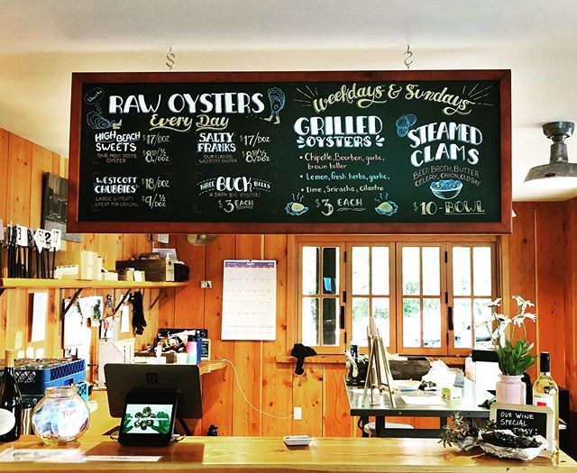 Updated the board for @westcottbayshellfishfarm and I'm really happy with the way it came out. I'm also hanging out there all summer cooking, so come by and say hi! #chalkboard #chalkboardmenu #sanjuanisland #fridayharbor