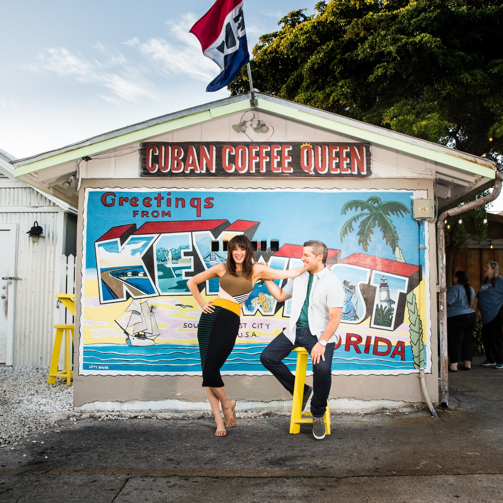 Engagement-Shoot-in-Front-of-Welcome-to-Key-West-Postcard-Mural-at-cuban-coffee-queen.jpg