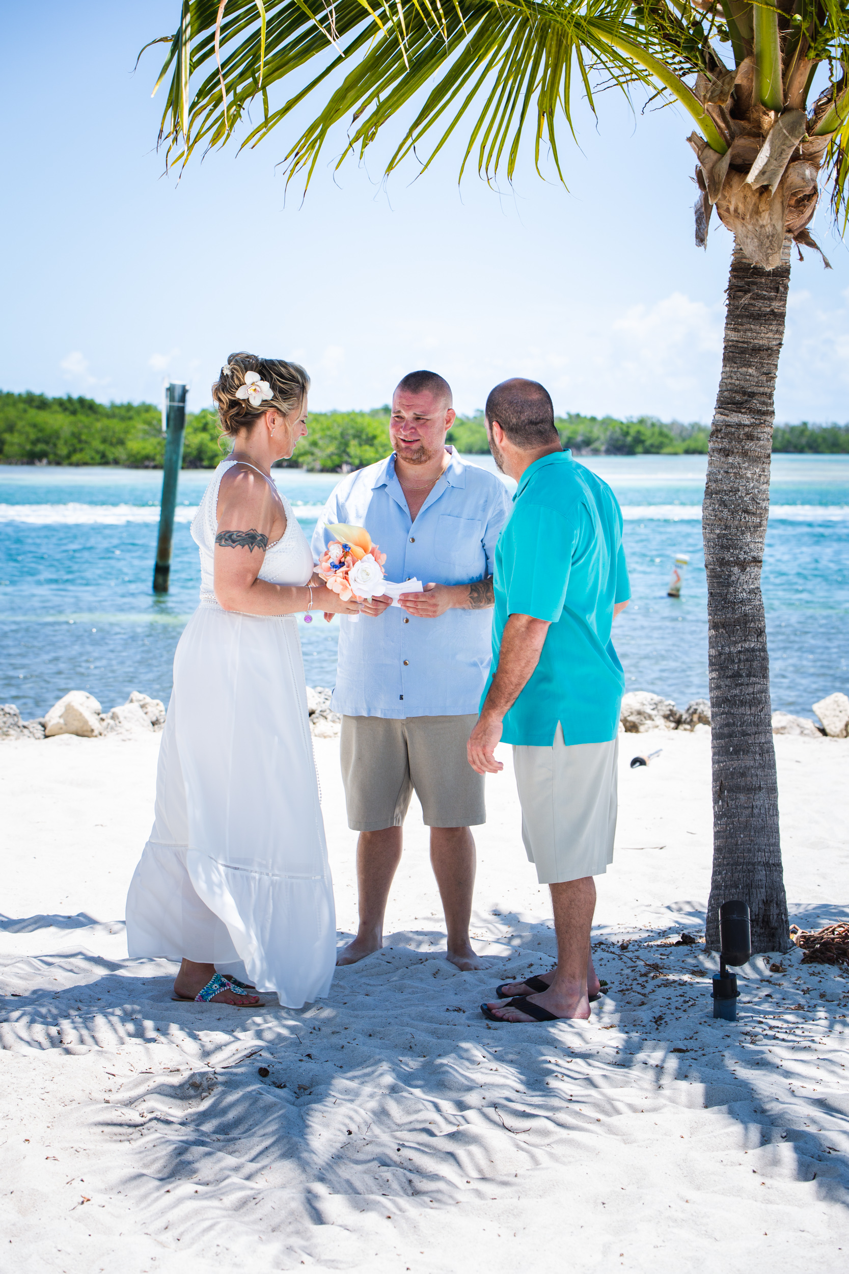 Couple get married under palm tree at Key West Harbour Yacht Club.jpg