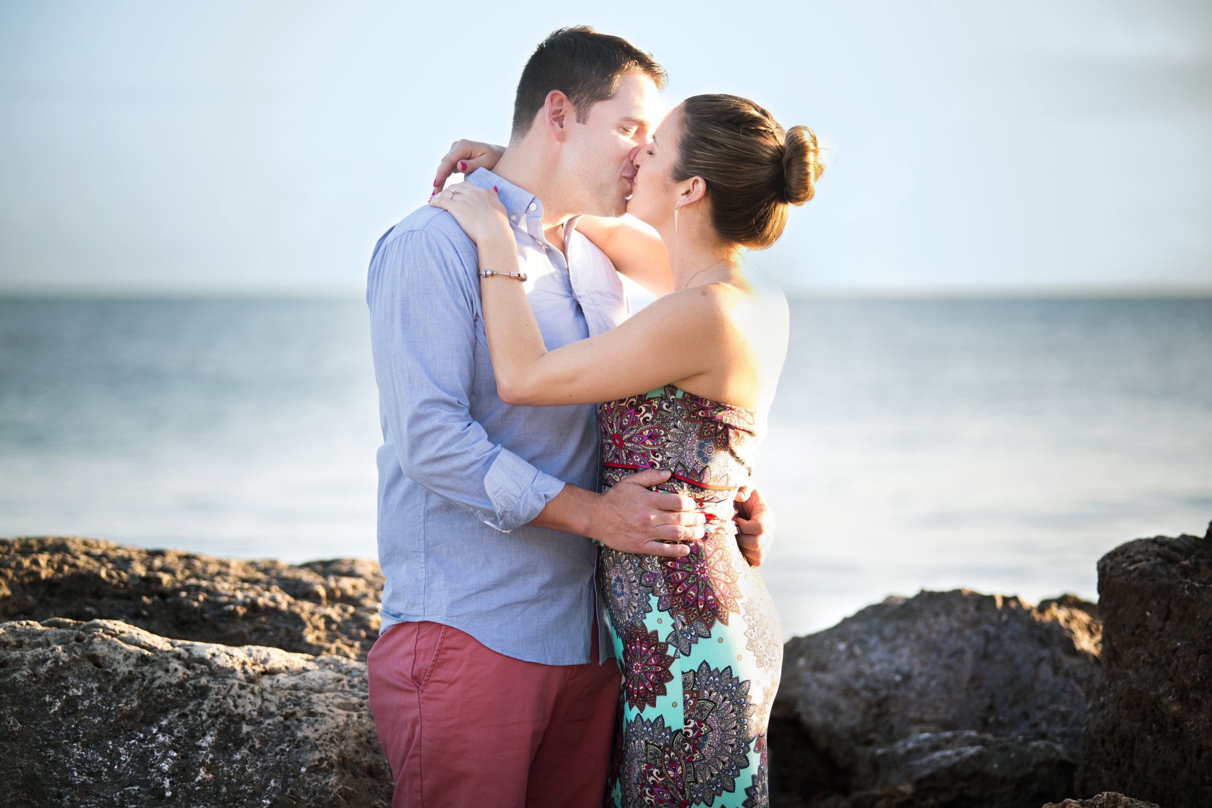 A kiss by the beach captured after the engagement