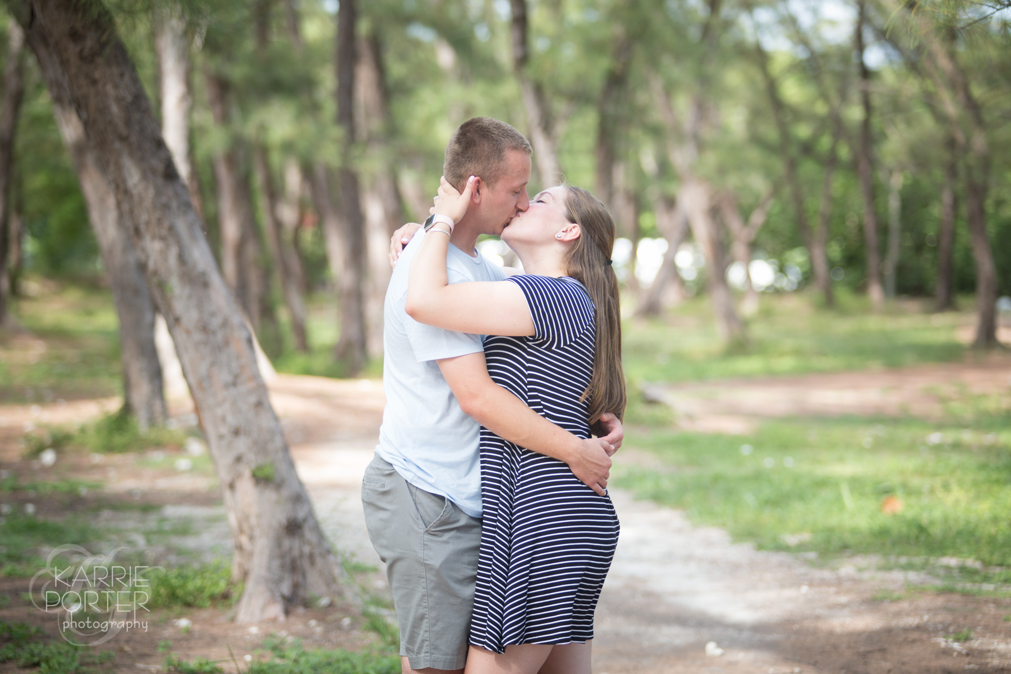 During a proposal photo shoot in Key West, Nick and Alyssa sneak a kiss under the Australian Pines of Fort Zachary Taylor State Park.