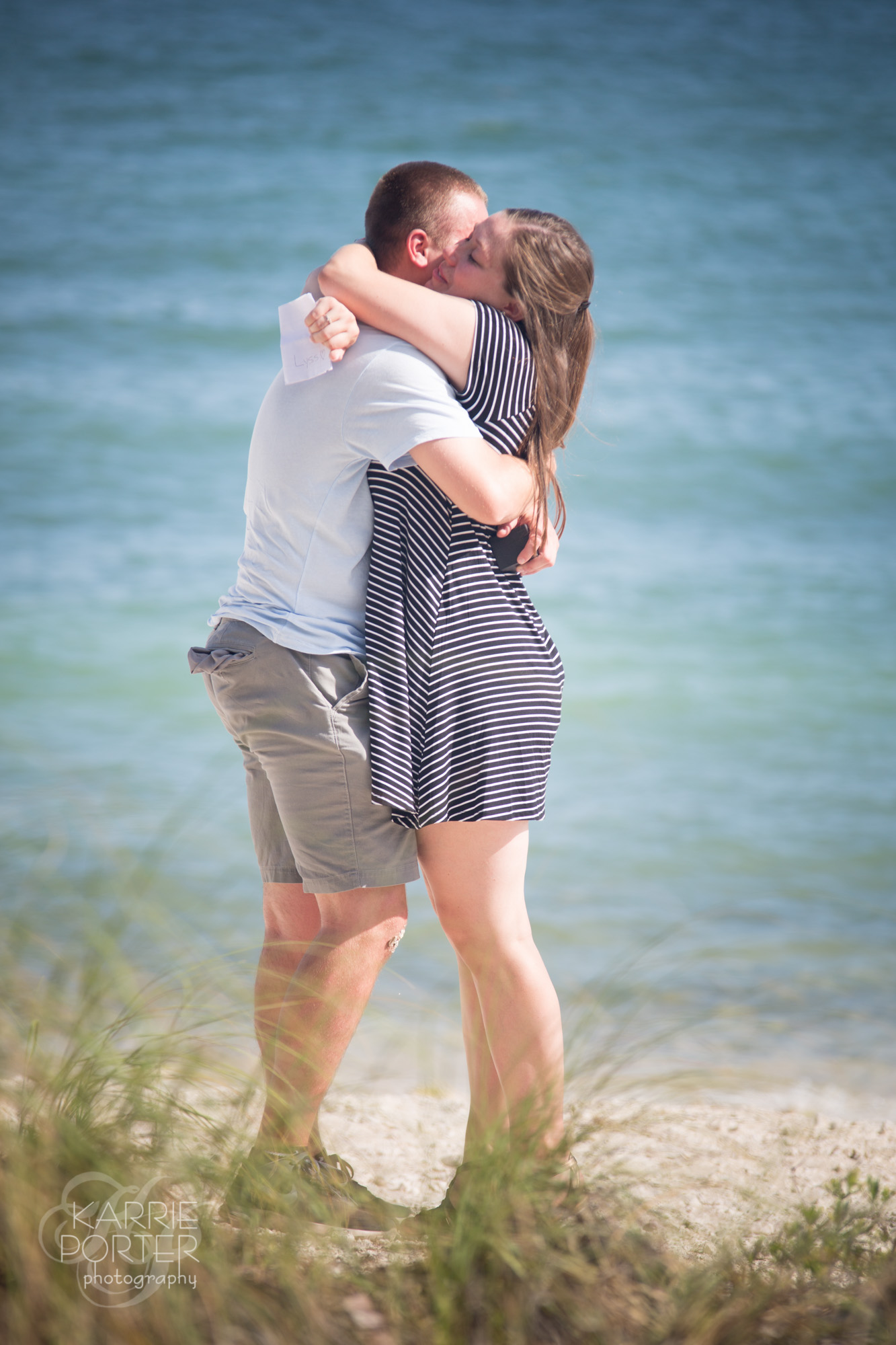 Guy and girl hugging after he pops the question