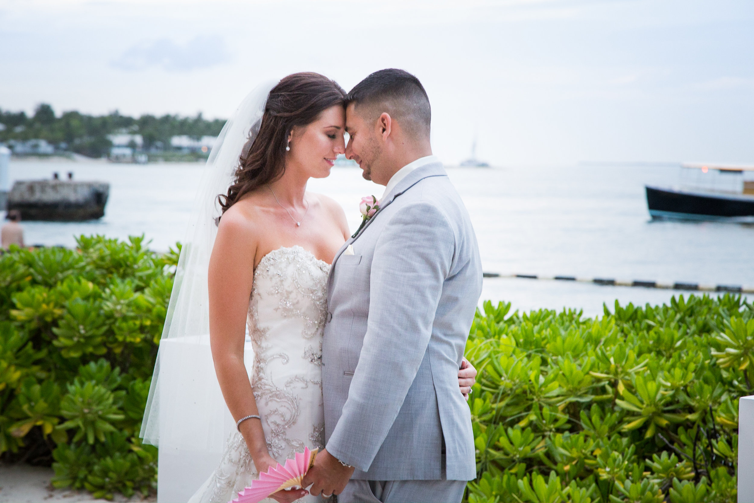 After getting married on the beach at the Pier House Resort in Key West, bride and groom Jennifer and Justin take a moment to enjoy each other's company with the ocean behind them
