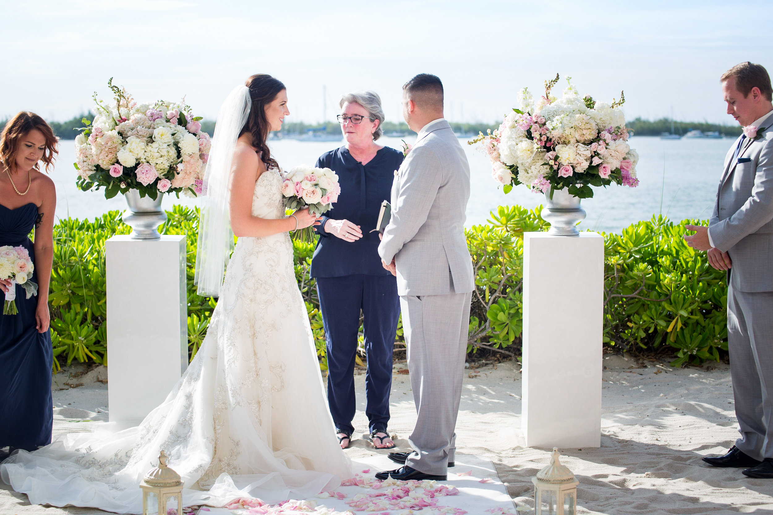 Patti Flowers officiates the unity of Jennifer and Justin with Maid of Honor and Best Man at both sides