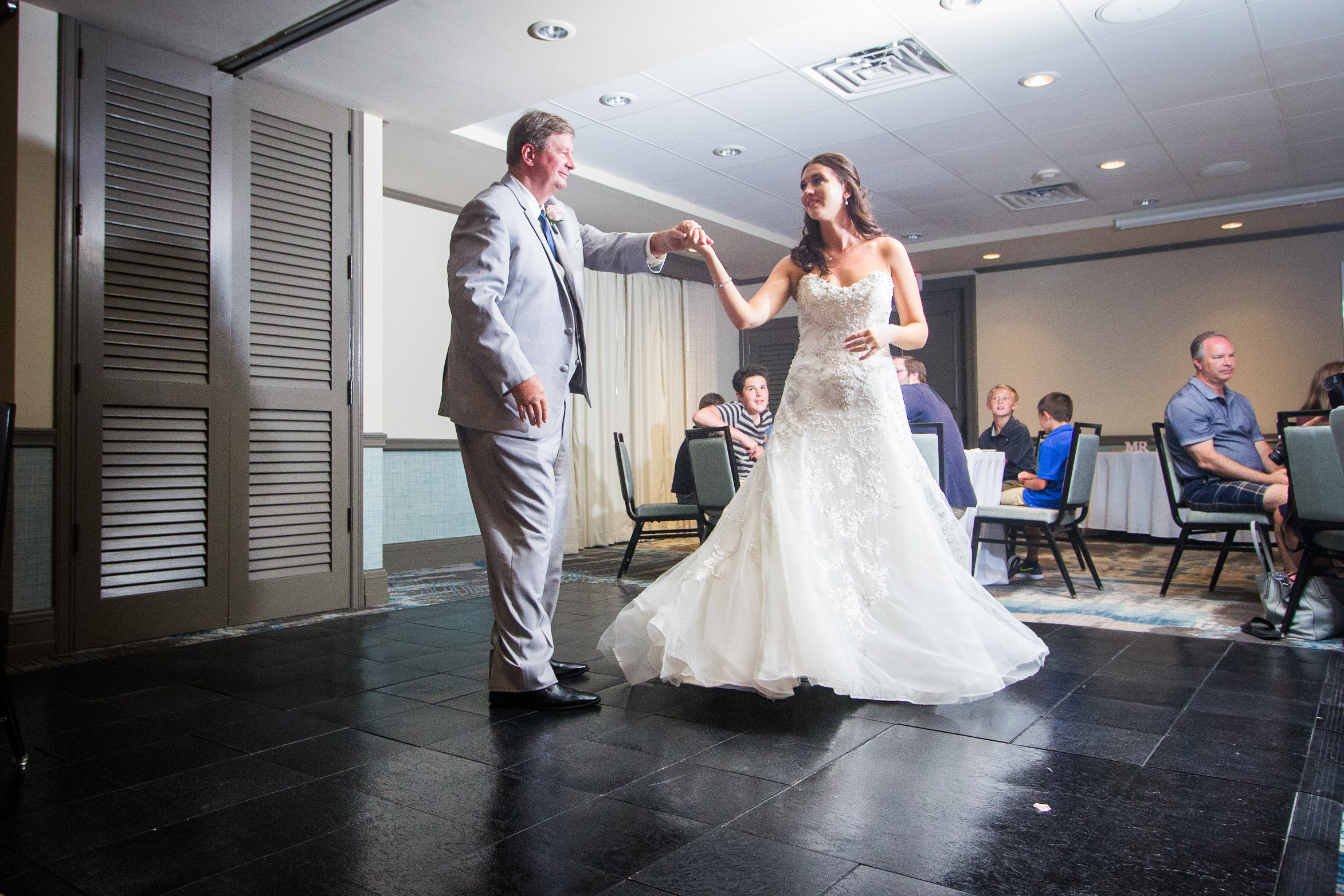 Capturing the closeness of the Bride with her Father as they dance in Pier House Ballroom.