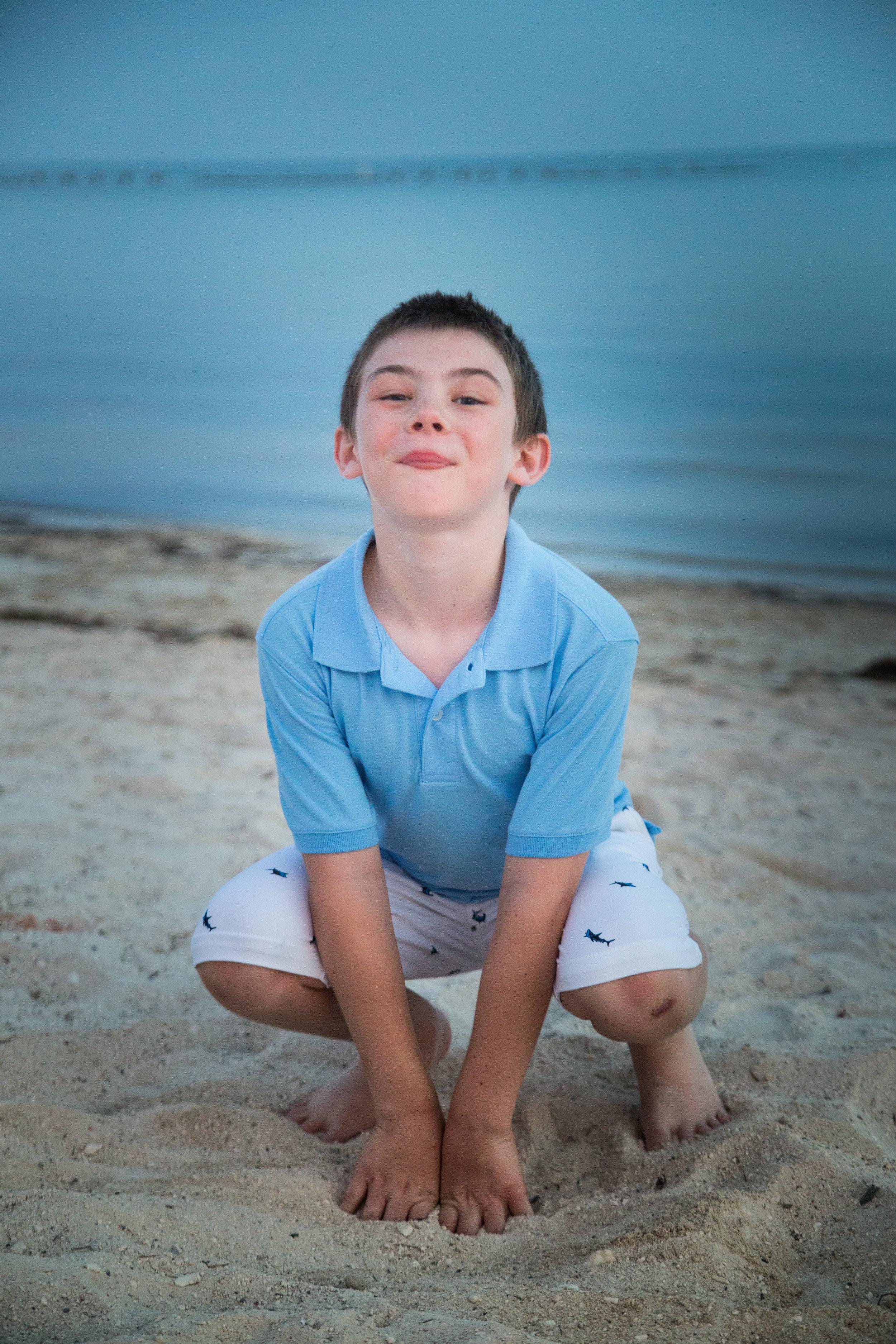 Cute-Kid-in-frog-pose-on-beach.jpg