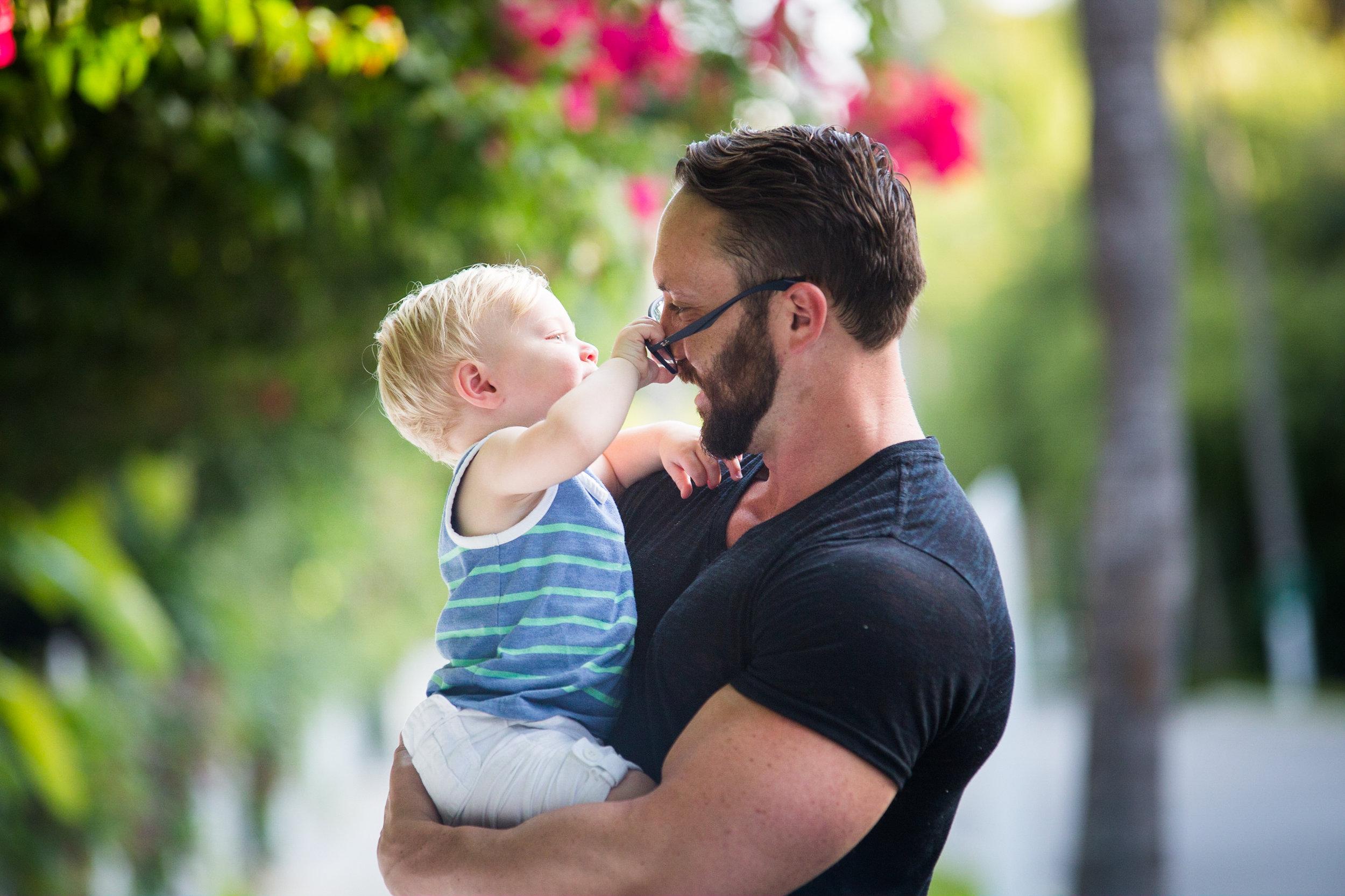 Little-Boy-Grabs-Dads-Glasses-During-Key-West-Family-Portrait-Session.jpg