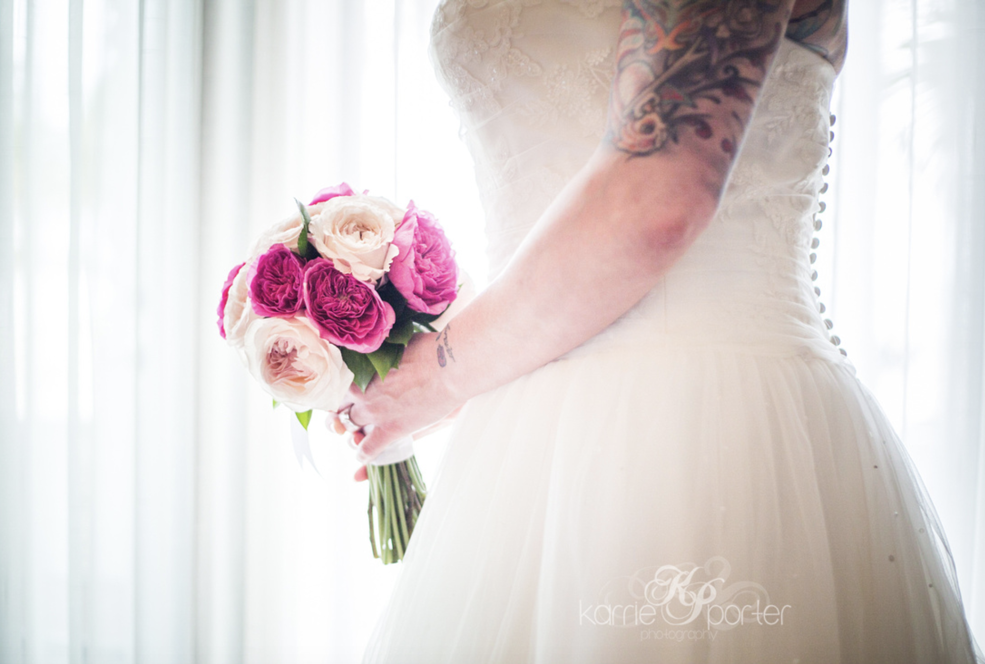 Bride-with-tattoo-arm-holding-flowers.png