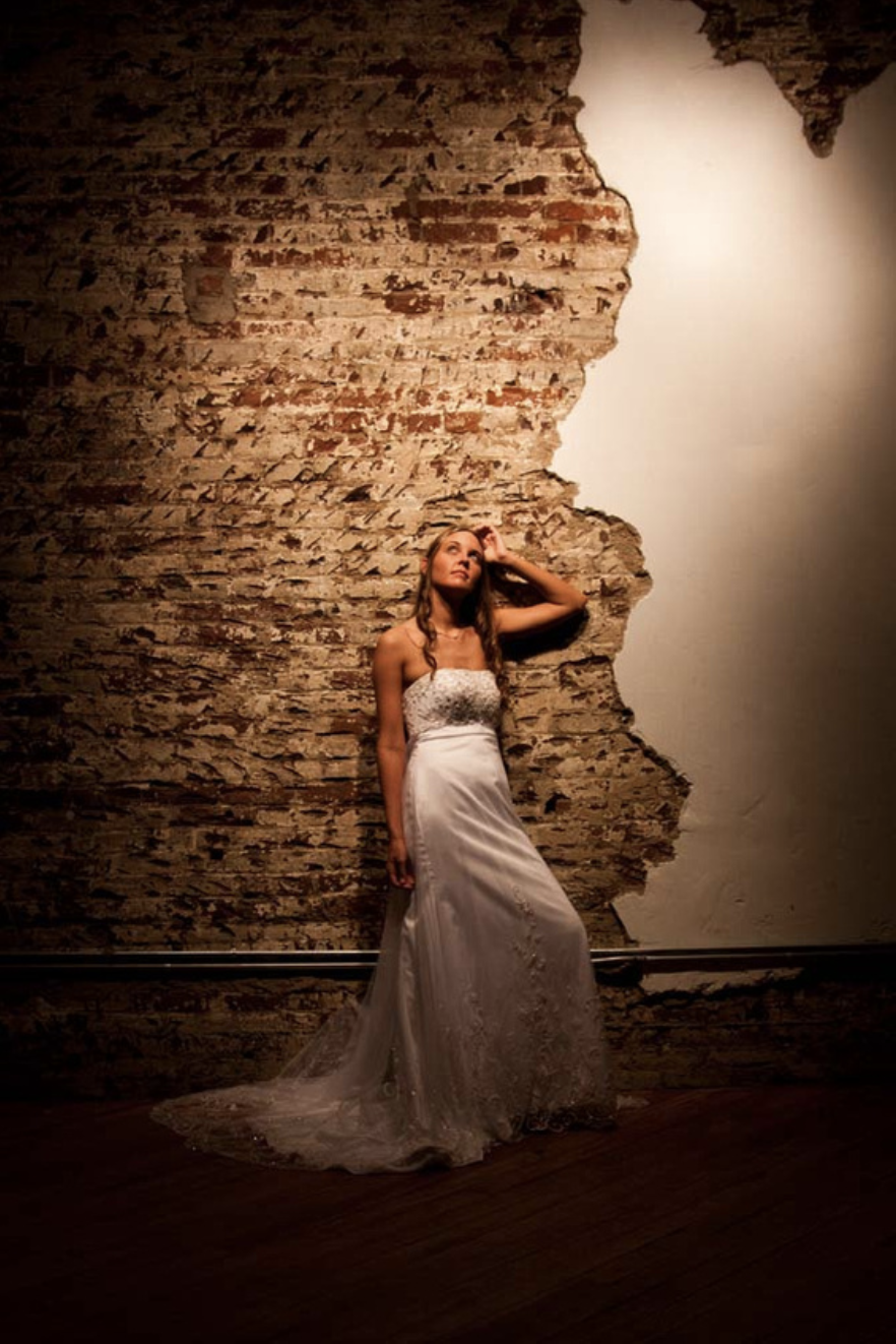 Dark-Moody-Portrait-Of-Bride-Against-Brick-Background.png