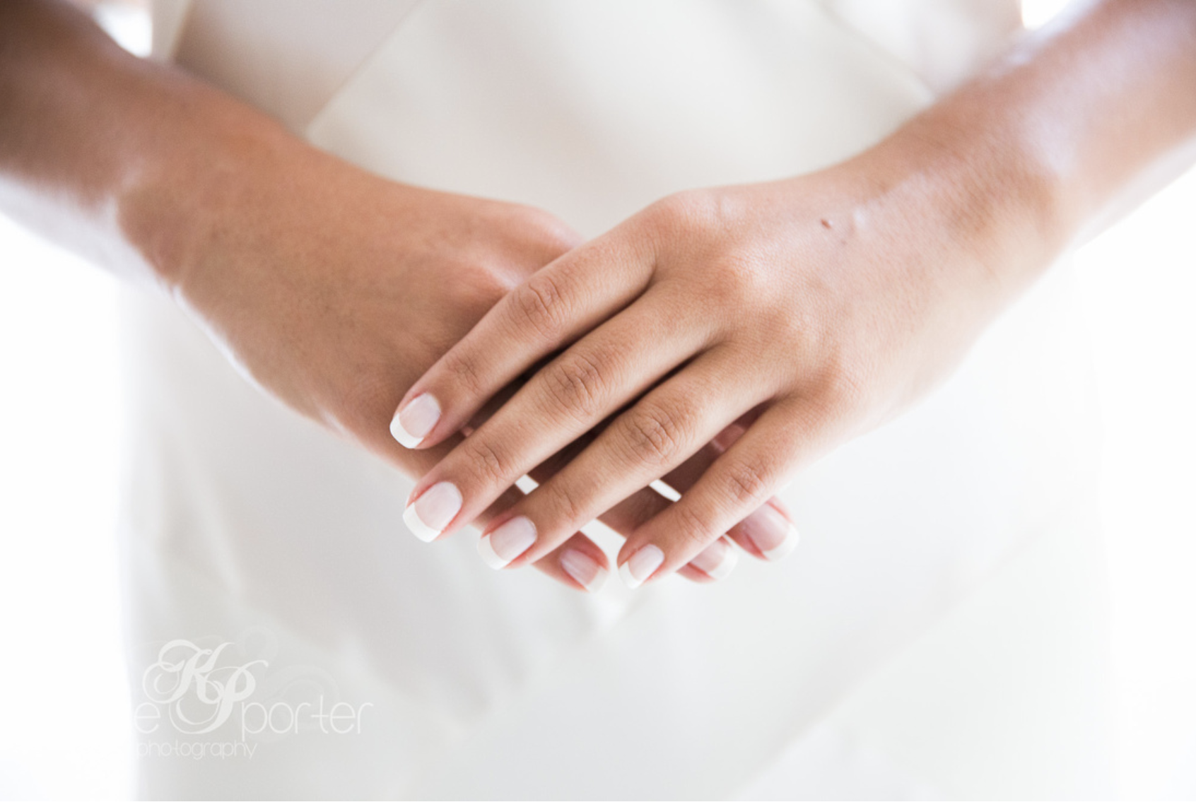 Bride-Holding-Hands-With-French-Manicure.png