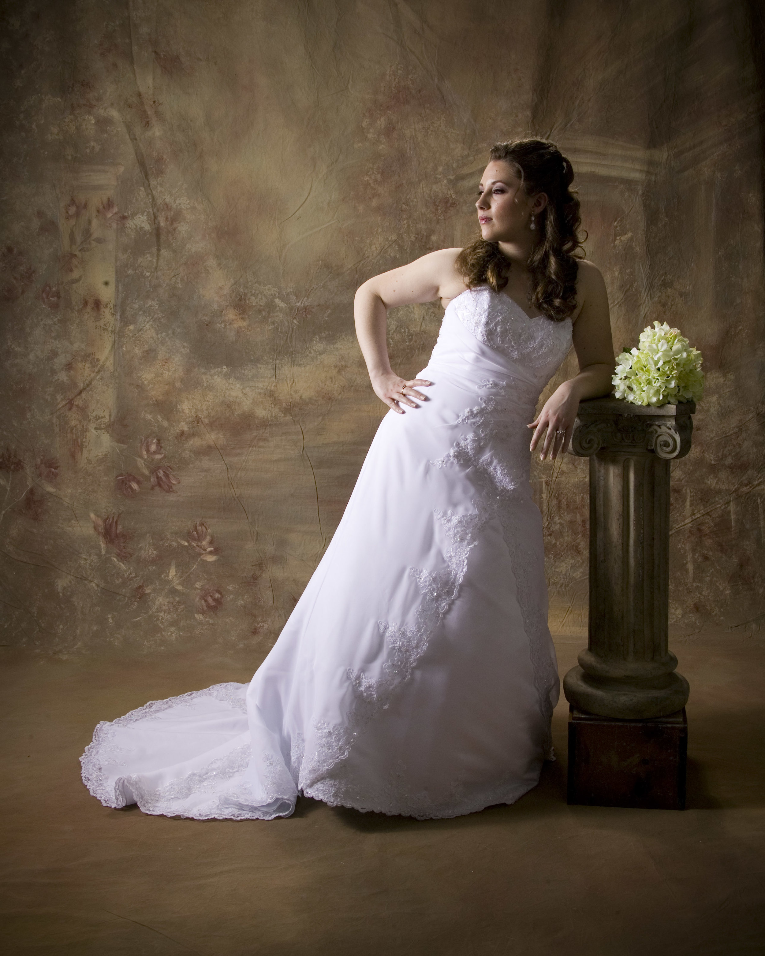 Portrait-Of-Bride-Against-Artistic-Studio-Background.jpg