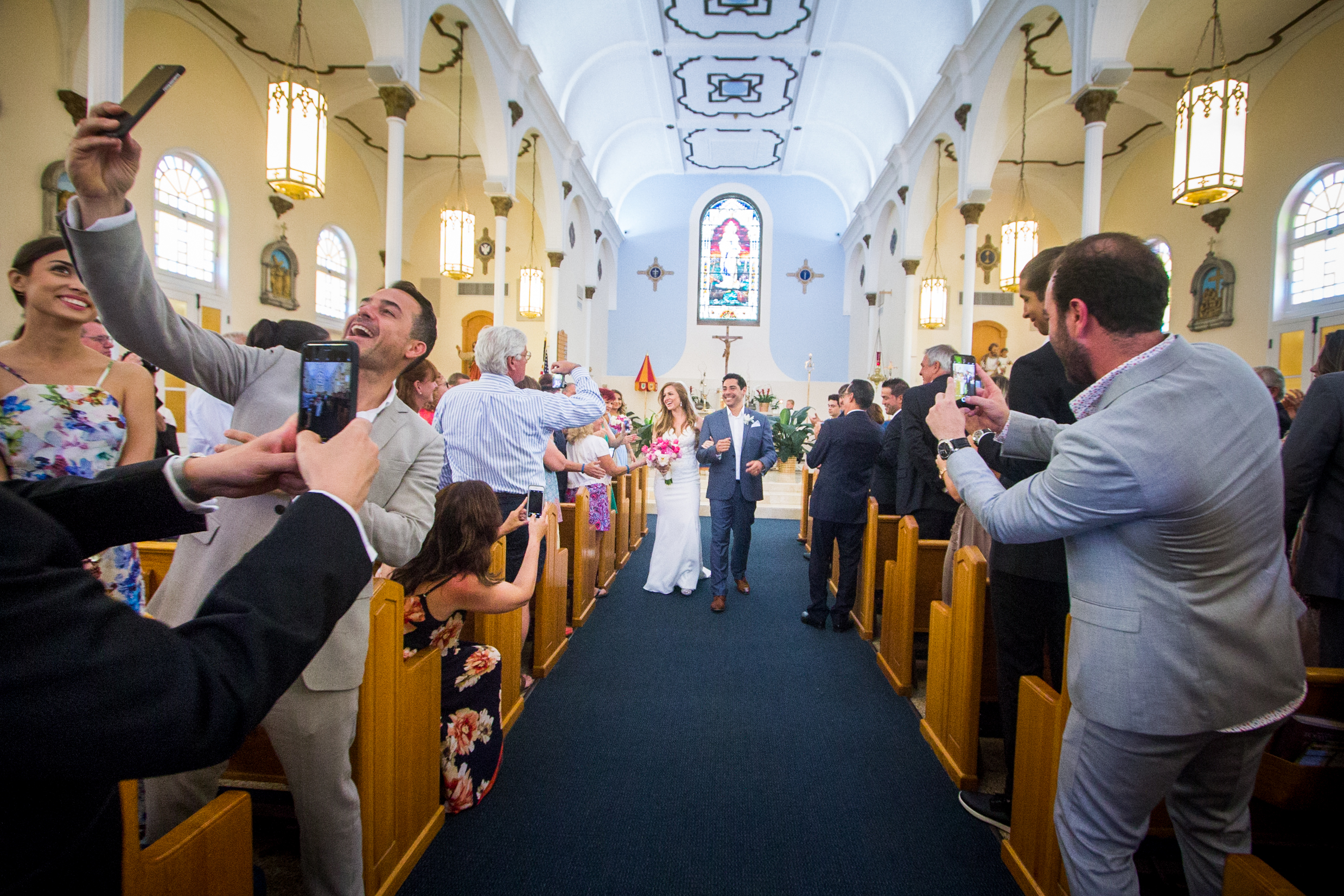 Married Couple Smiles for iPhone Pictures Walking Down Aisle at St Marys Basilica in Key West