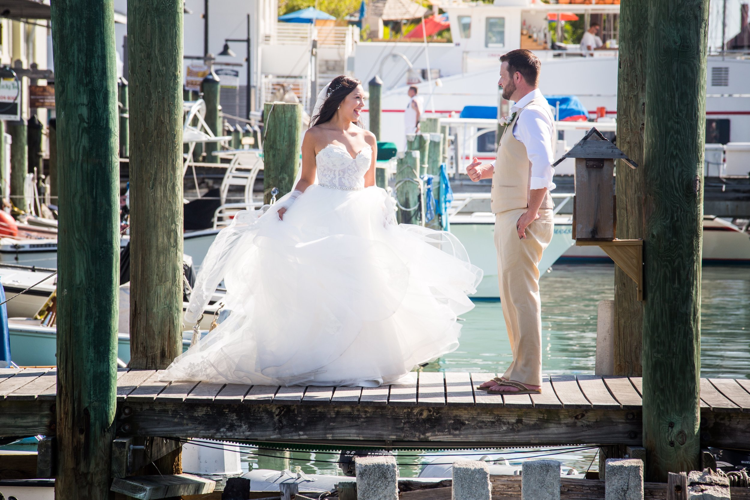 Playing with wedding dress on the docks in Key West Bight
