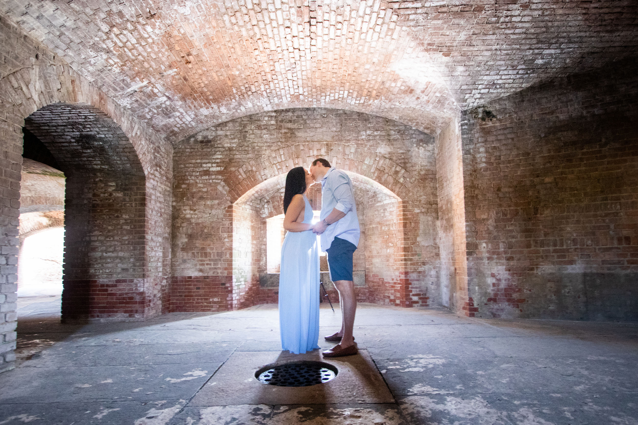 Couple sneak a kiss after their undercover engagement at Fort Zachary in Key West