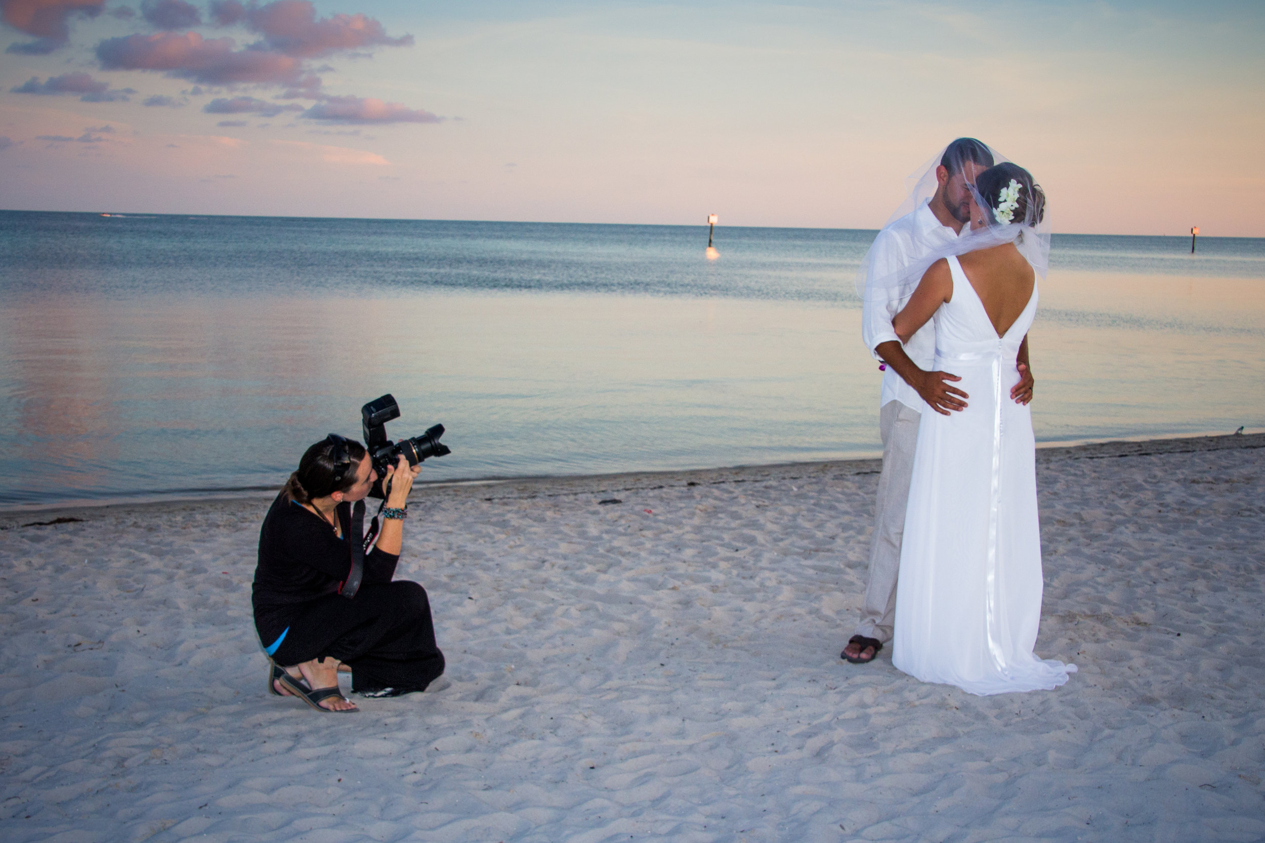Karrie Porter Key West Photographer taking picture of bride and groom on beach
