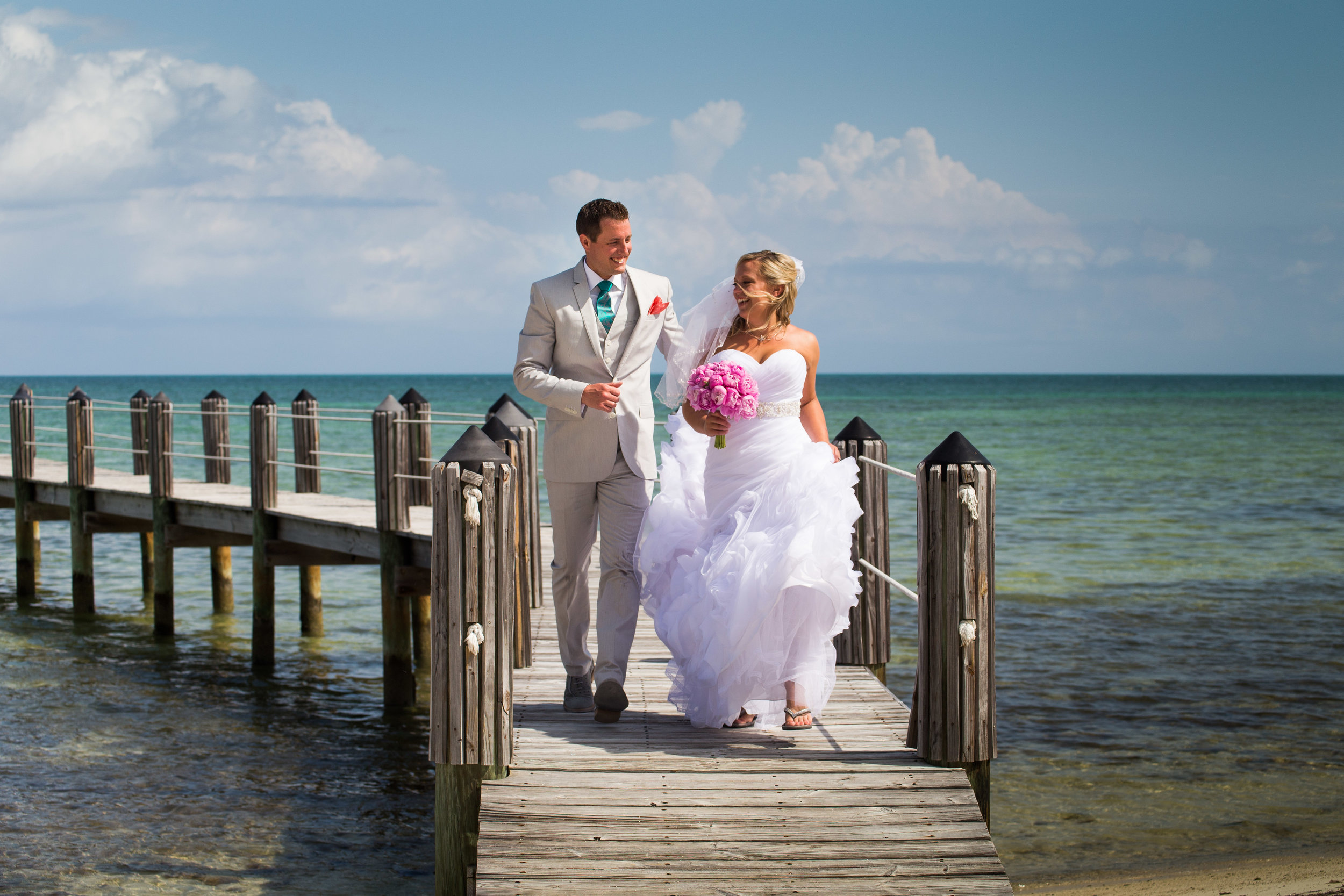 Her hair was blowing in her face, but do you think this bride was thinking about that? No, she was having a blast running down the dock with the love of her life.