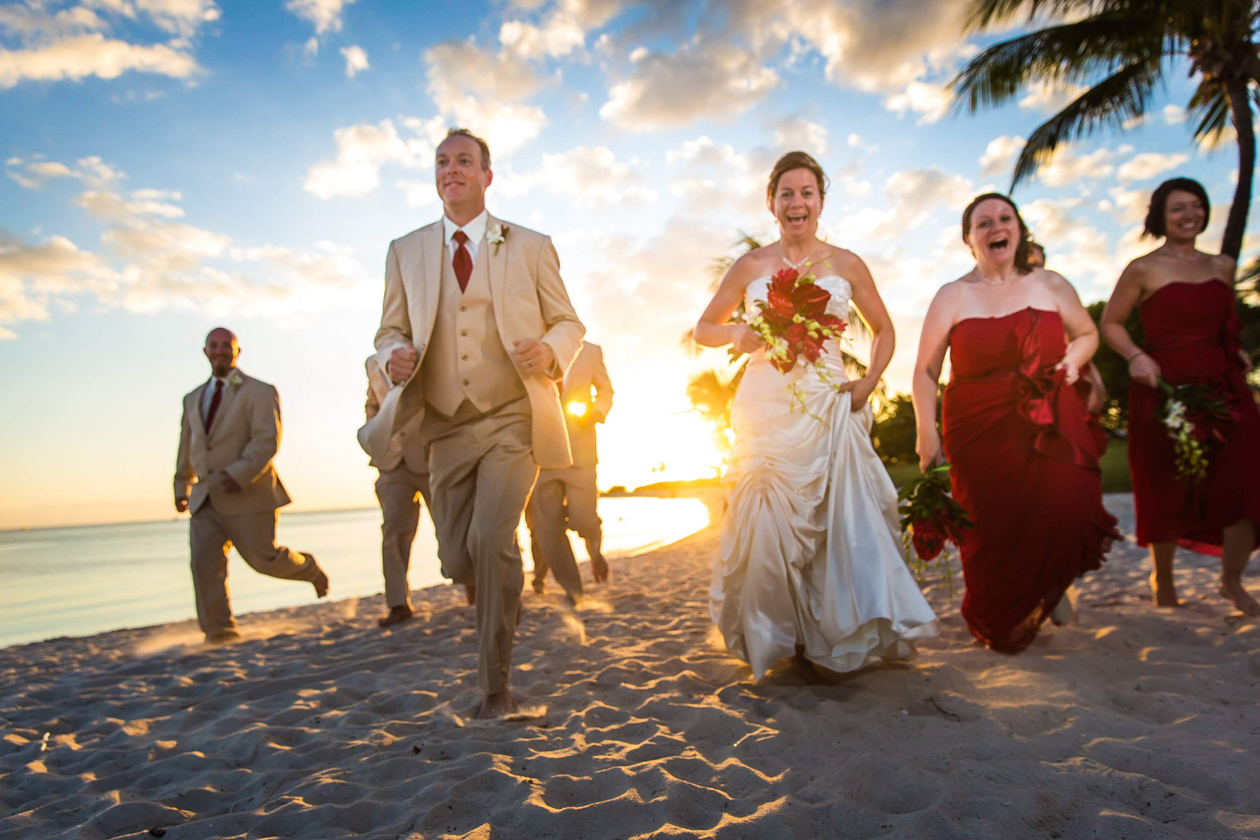Newlyweds Running Down Sombrero Beach in Marathon Florida.jpg