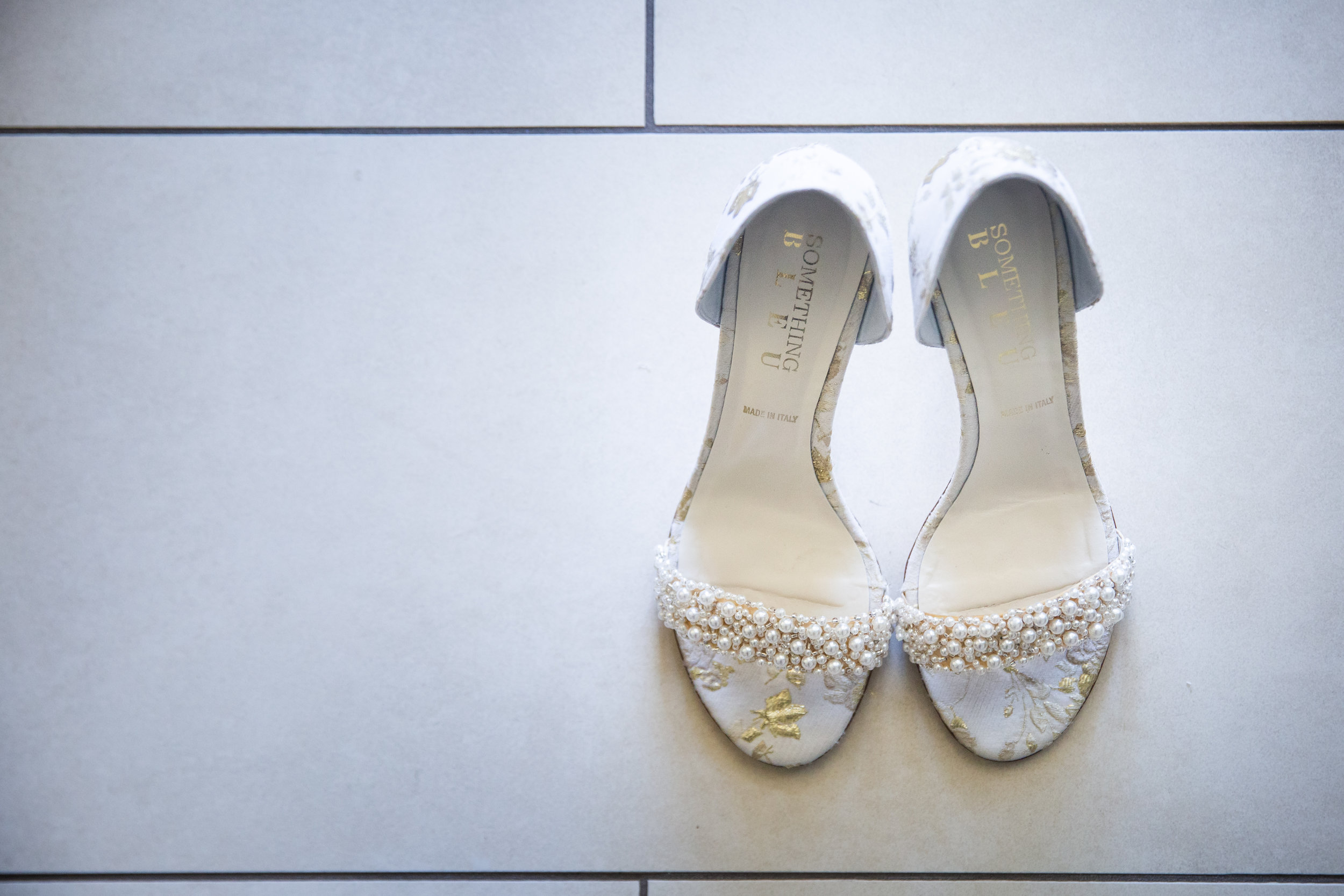 Brides Shoes with White pearls on tile floor.jpg