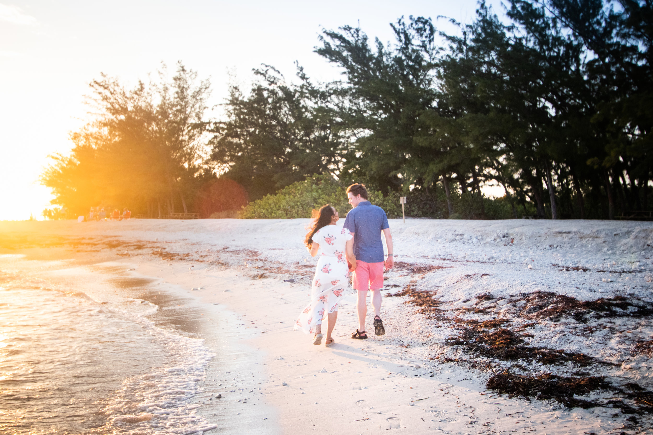 Secret Engagement session with couple walking on beach.jpg