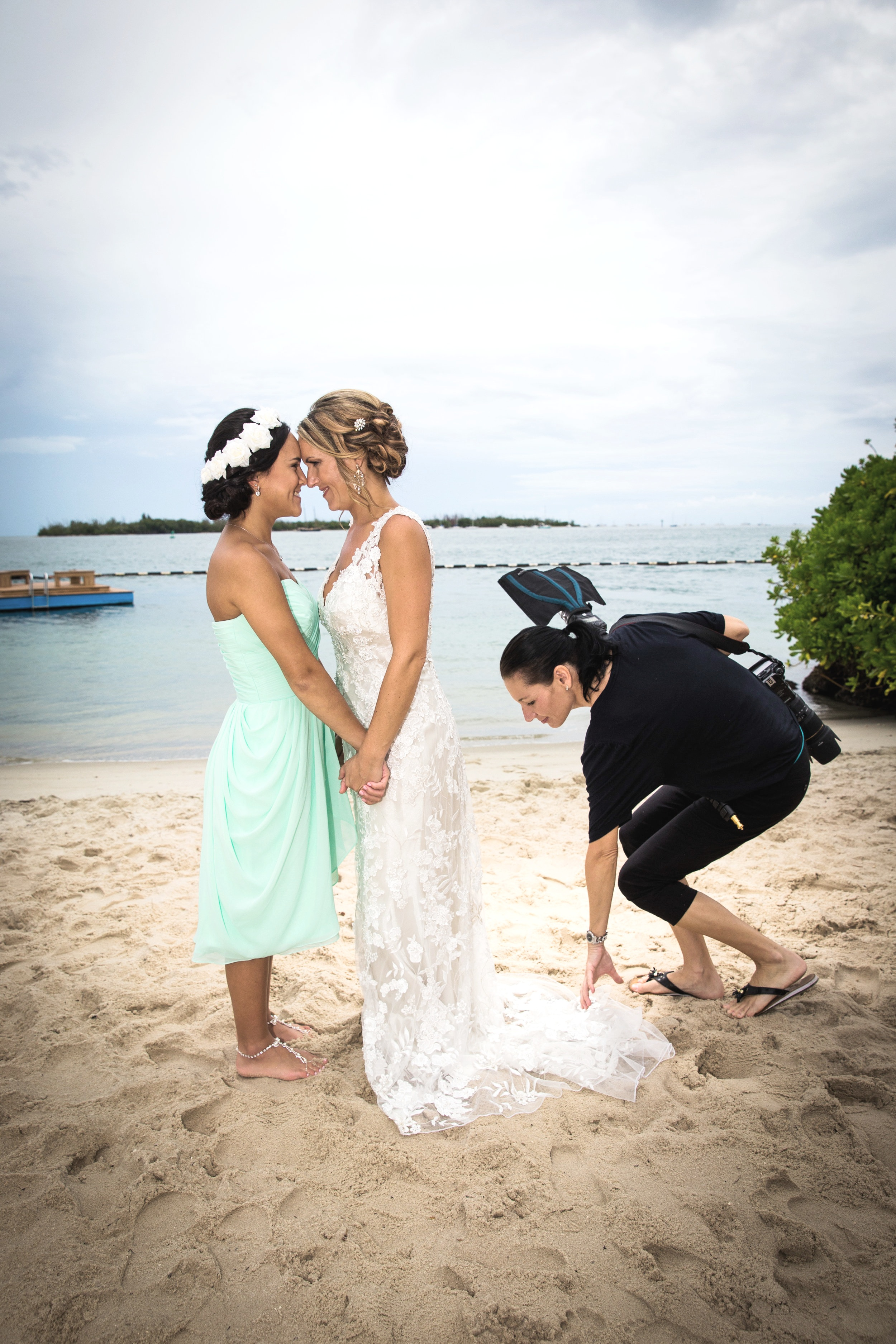 Photography Assistant Spreading out the train of the dress on a Key West wedding day.jpg