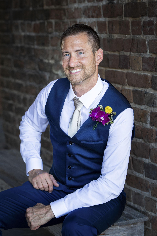 Groom seated before Key West wedding