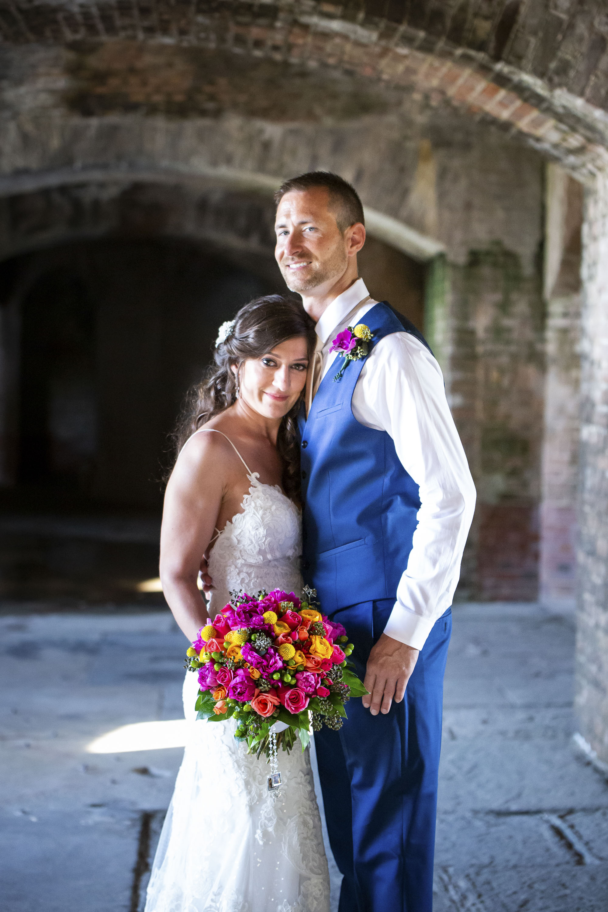 Couple getting married under fortress arches