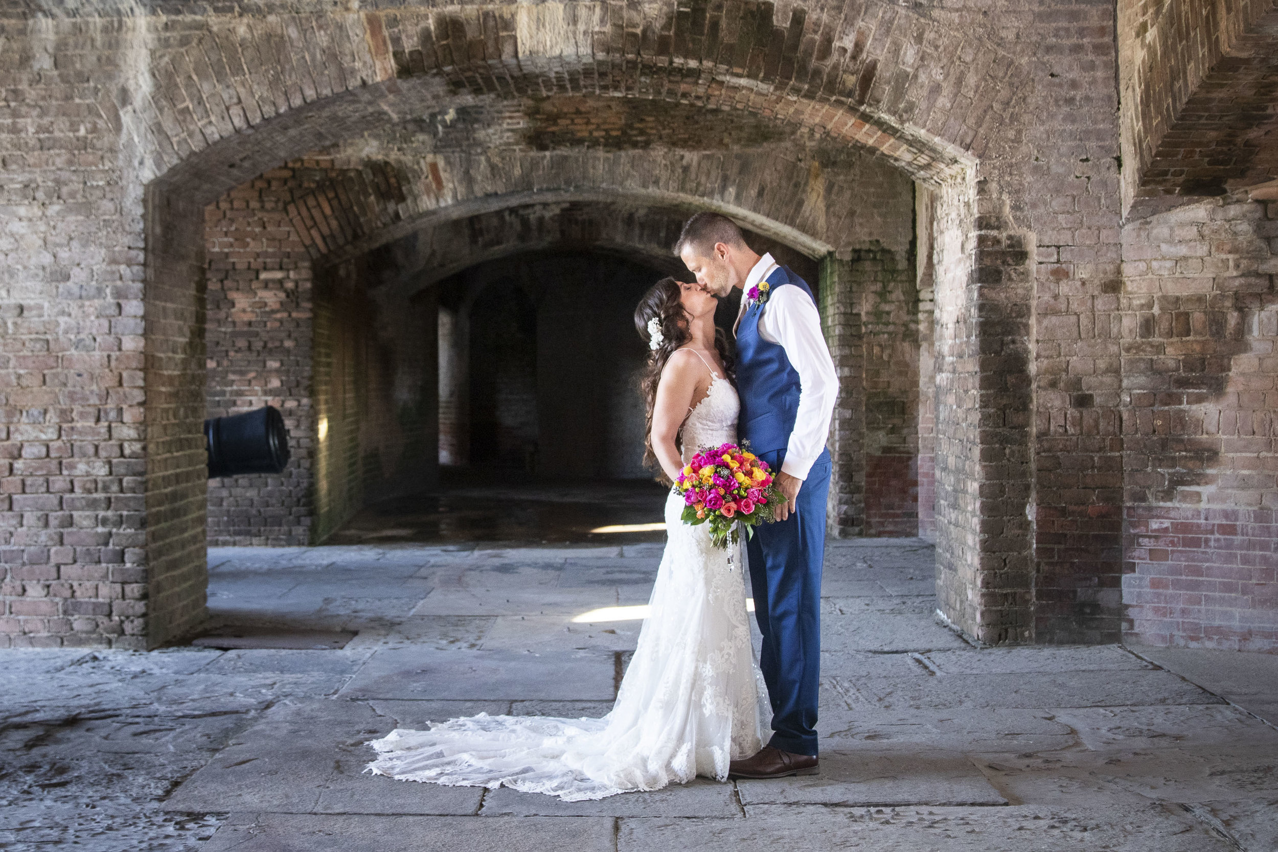 Bride and groom kissing before their wedding