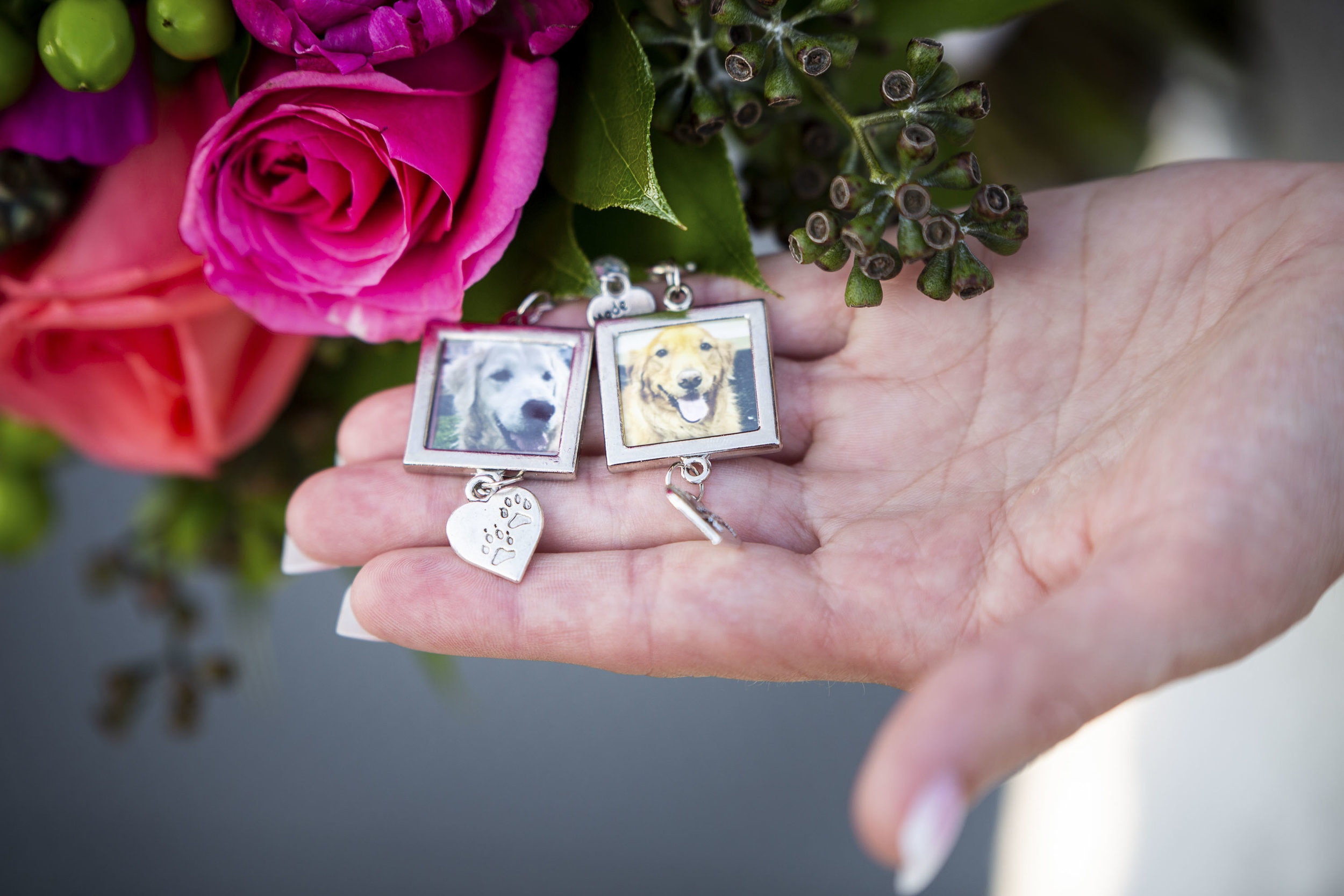 Unique wedding idea bringing deceased pets to wedding as charms on the bouquet