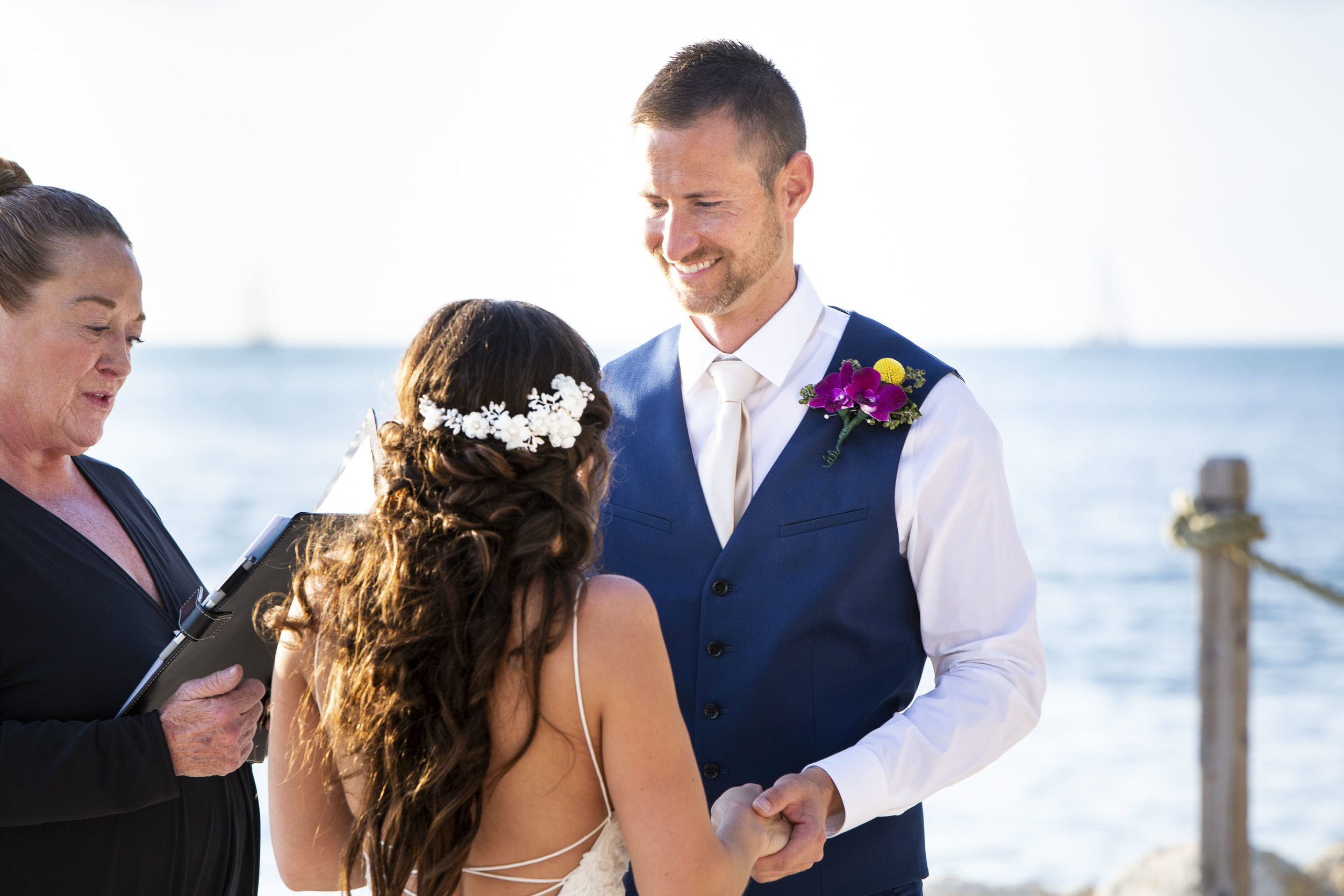 Groom smiling at his bride during wedding at Fort Zach