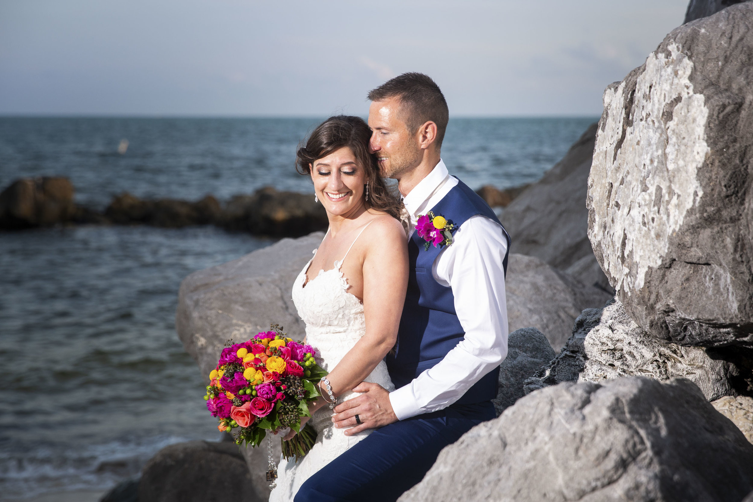 Snuggling on the rock jetty at Fort Zach after a Key West wedding ceremony