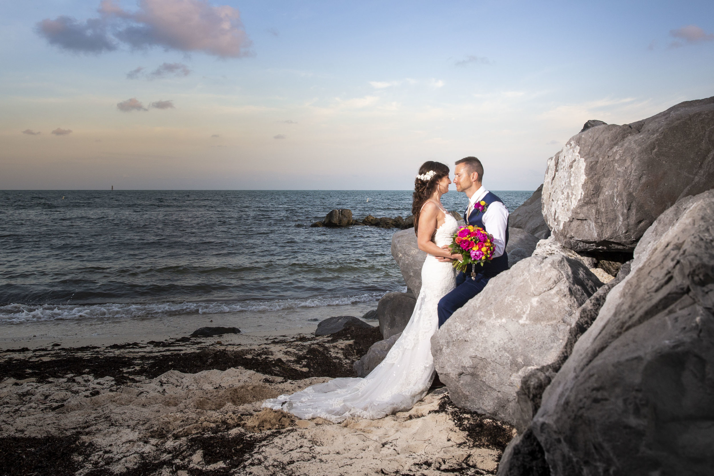 Key West wedding photographer captures couple on the rock jetty of the beach