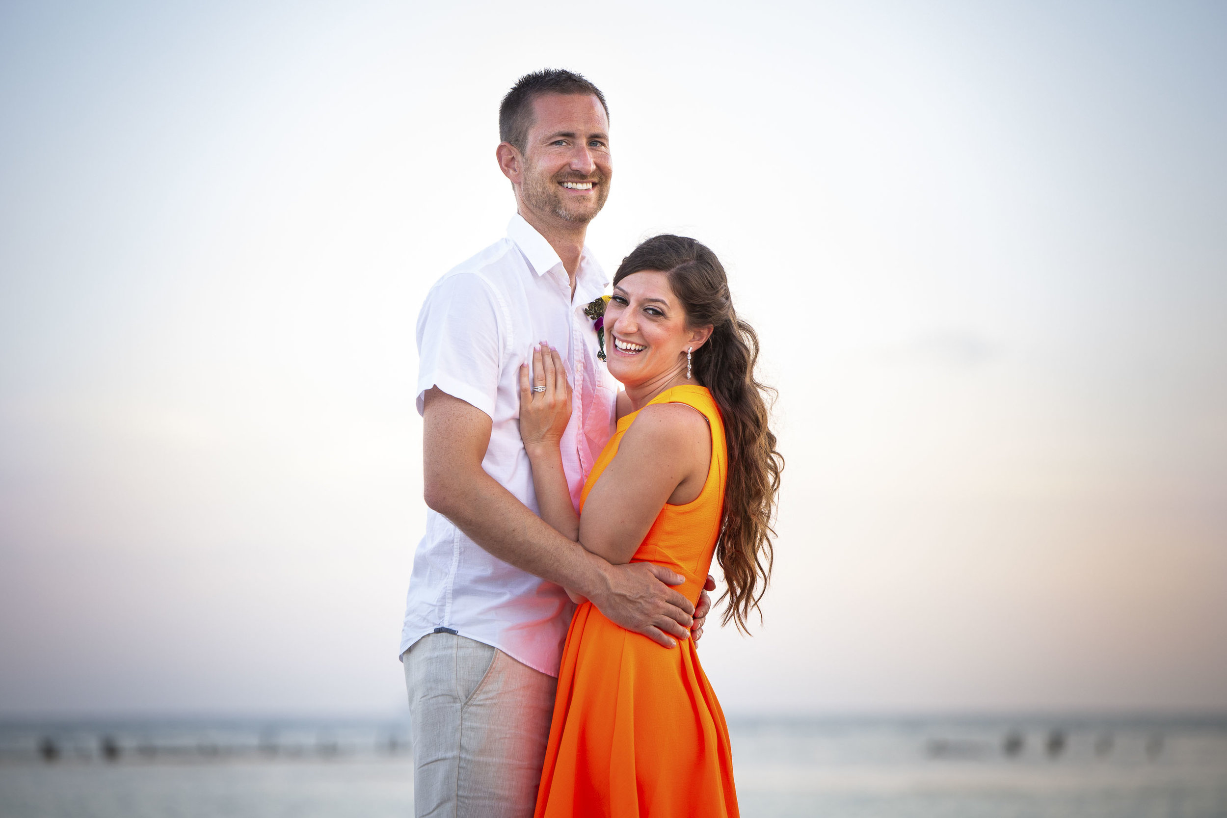 Married couple laughing with Key West photographer
