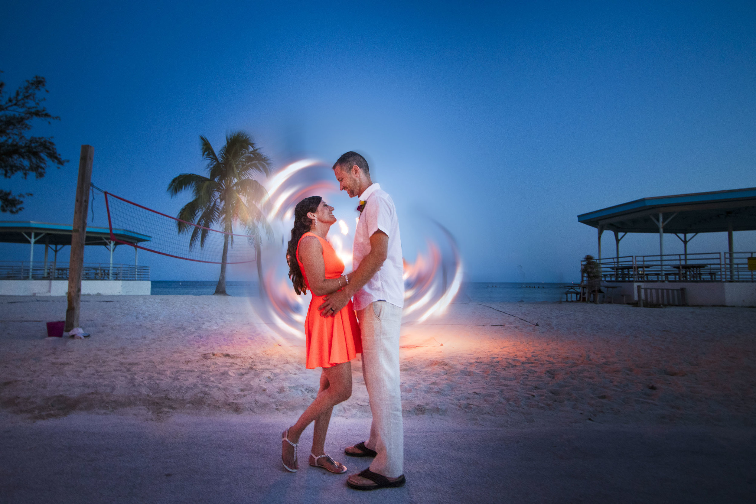 A fire dancer provides a swirl of flame as Key West photographer captures couples portraits