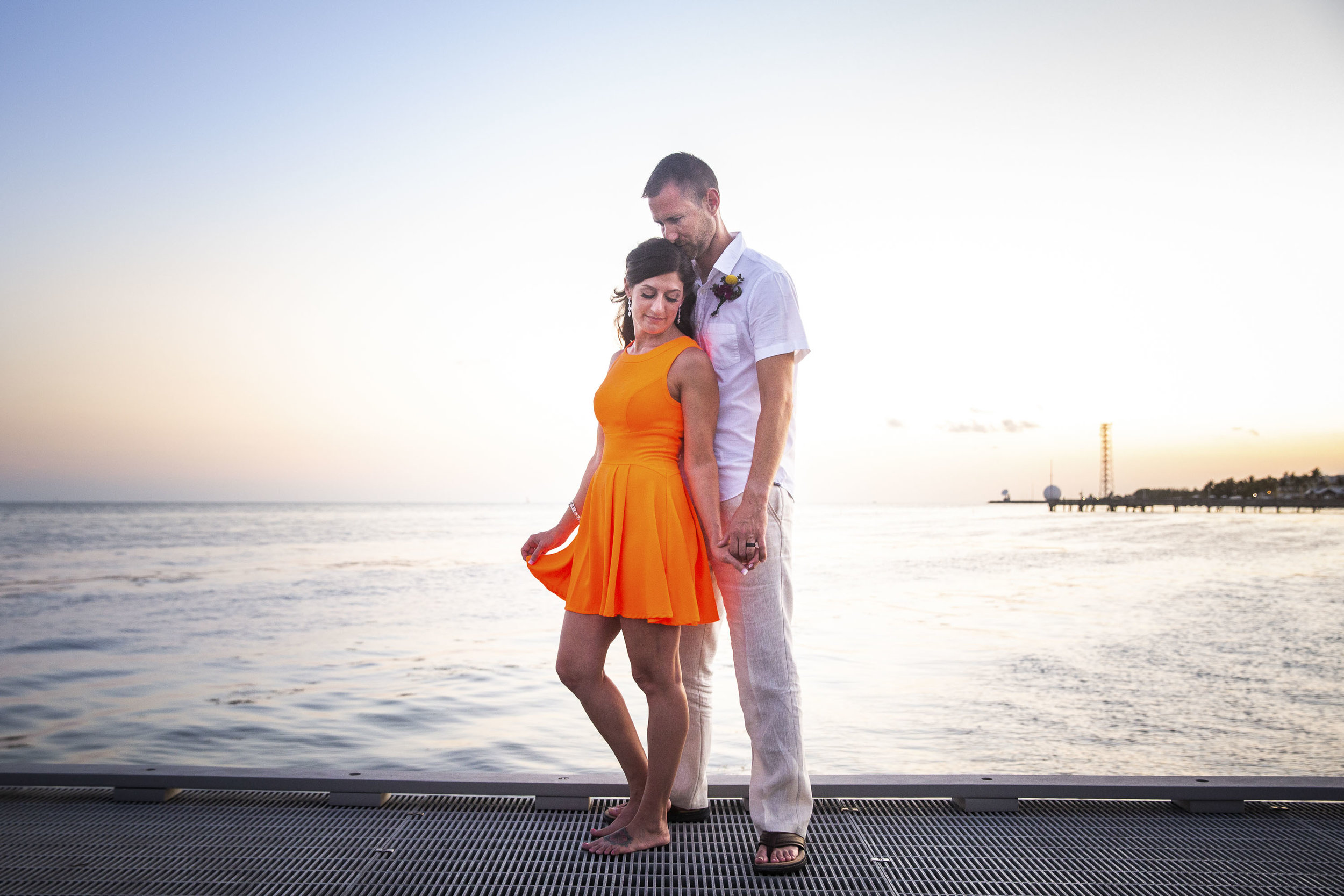 Enjoying a quiet moment together as Key West photographer captures couples portraits