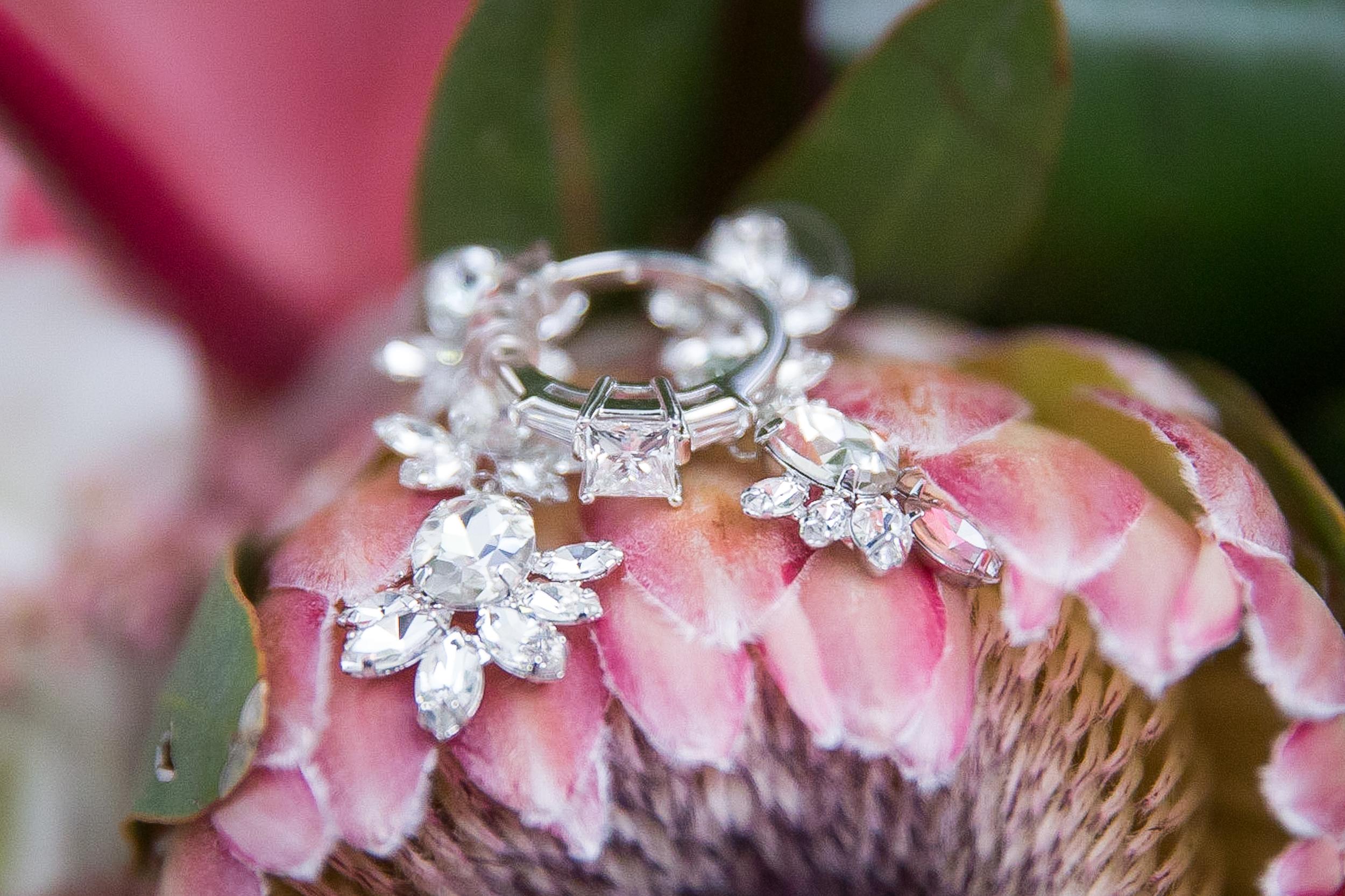 Wedding ring on pink peoniesjpg