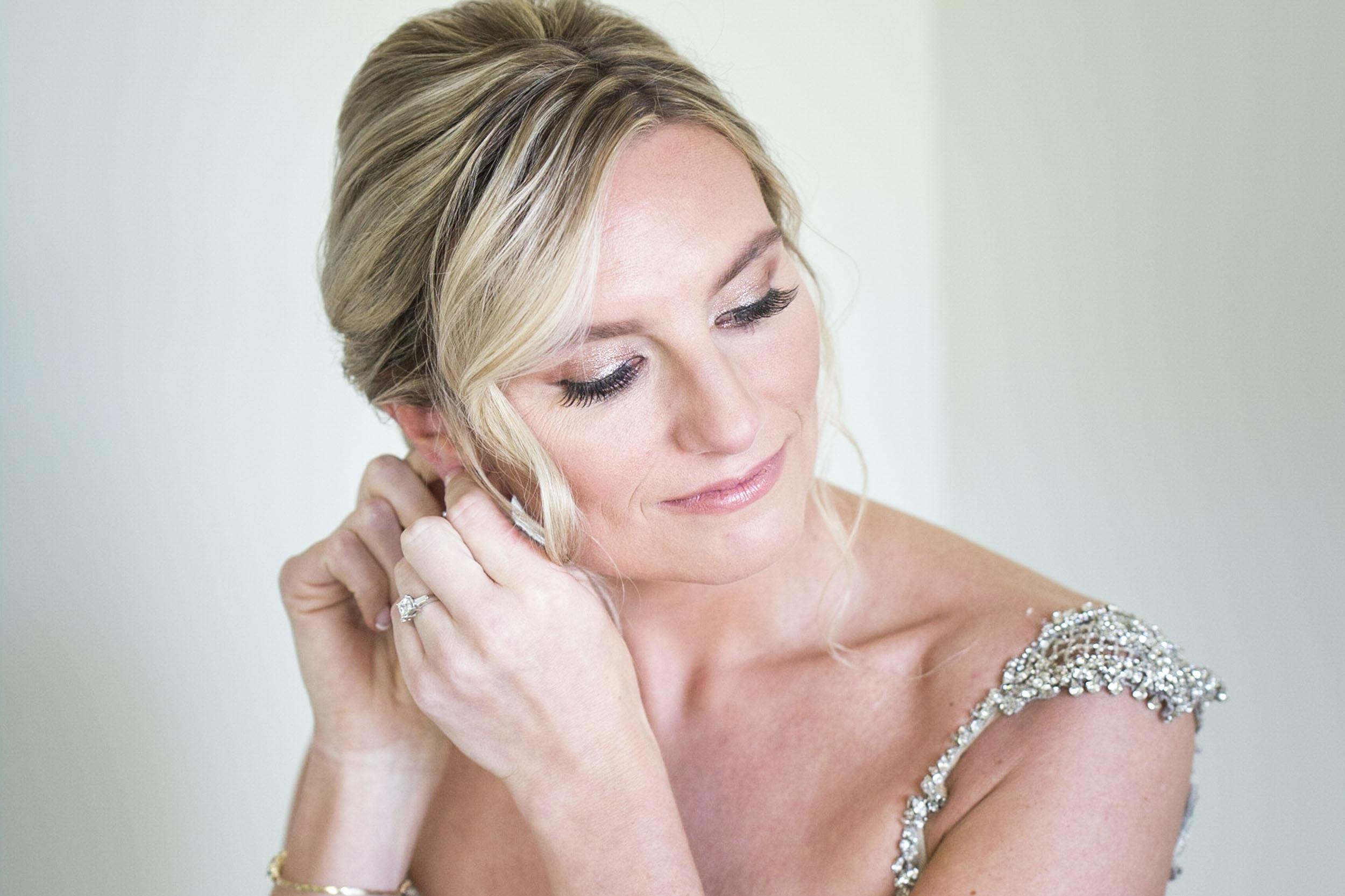 Bride-putting-on-earrings.jpg