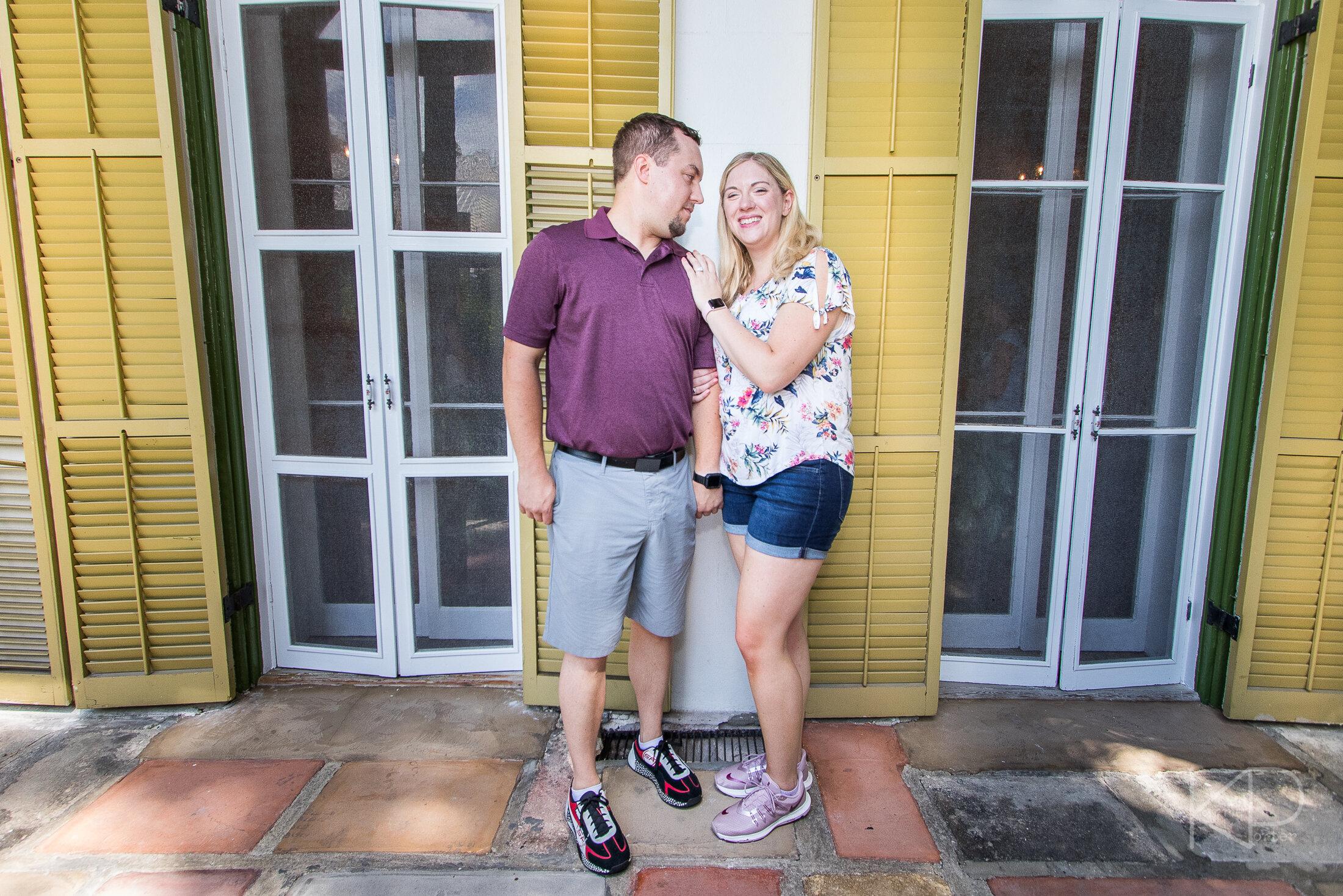 Couple enjoying engagement photos outside the Hemingway Home