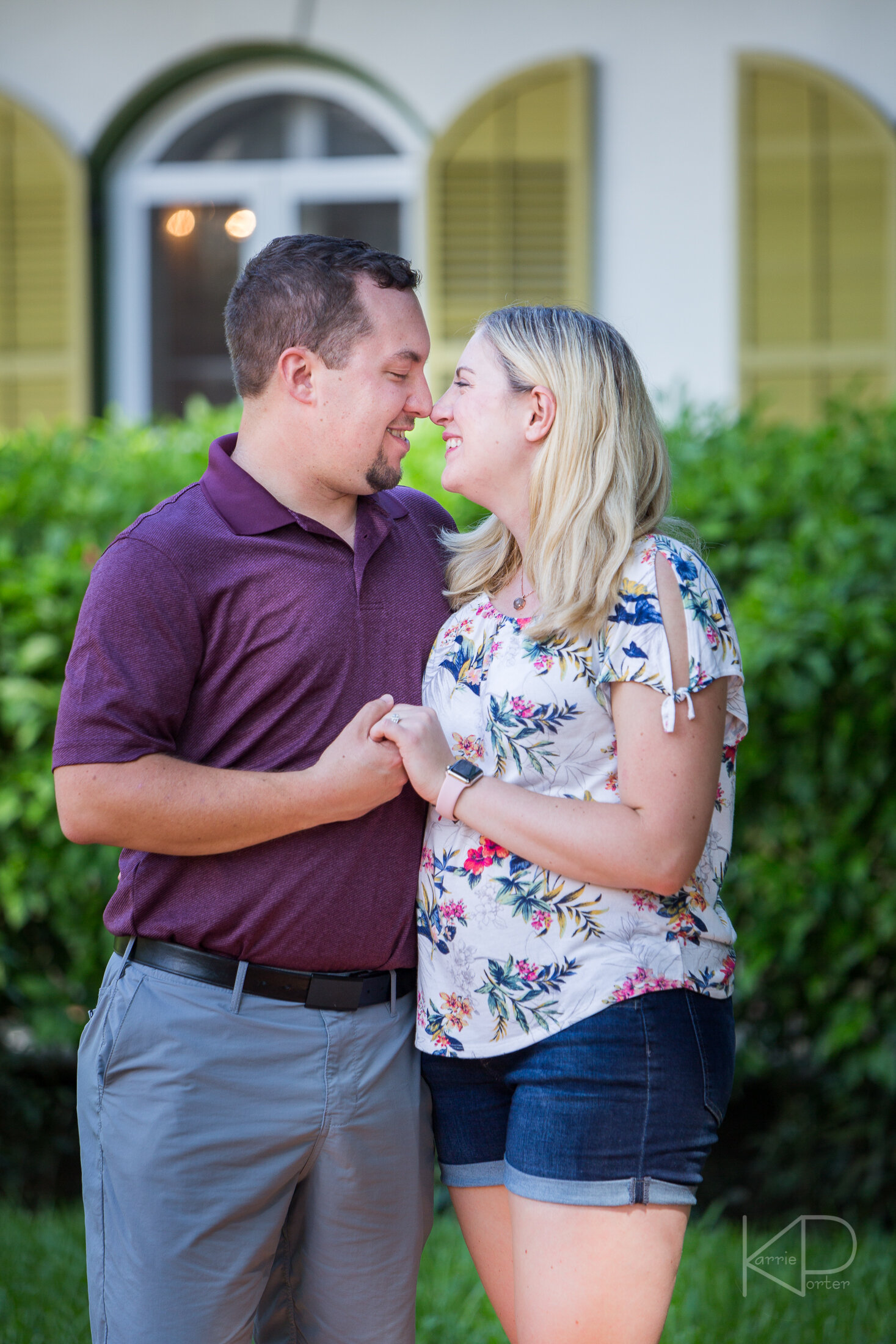 Newly engaged couple smiling at each other during their Hemingway House proposal