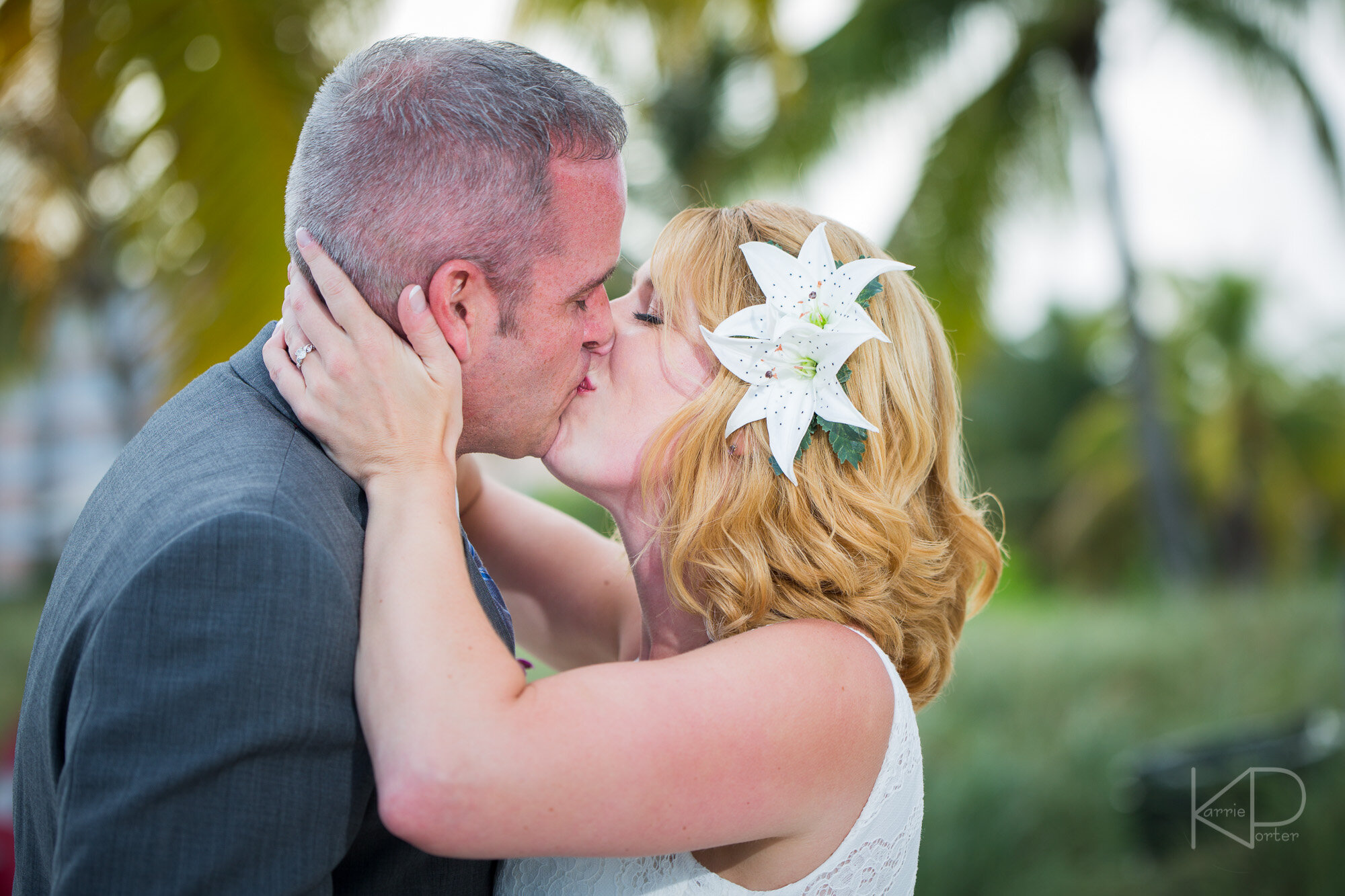 Groom standing under fortress arches before Key West wedding