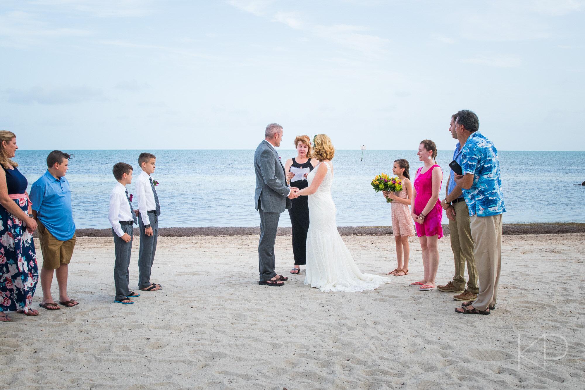 Key West photographer Karrie Porter captures bridal couple under historic fortress arches