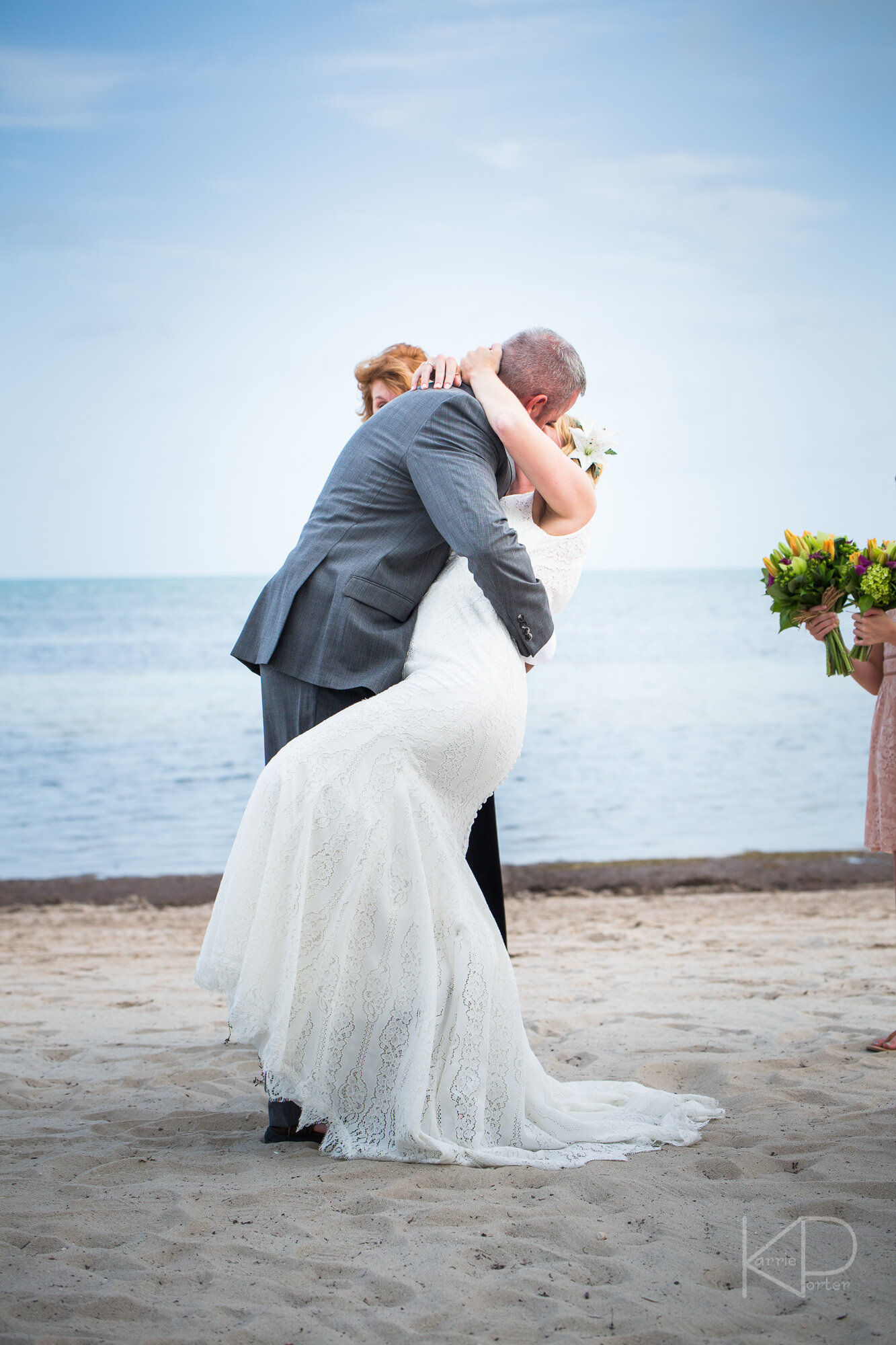 Bride walking with her father down the aisle at the beach