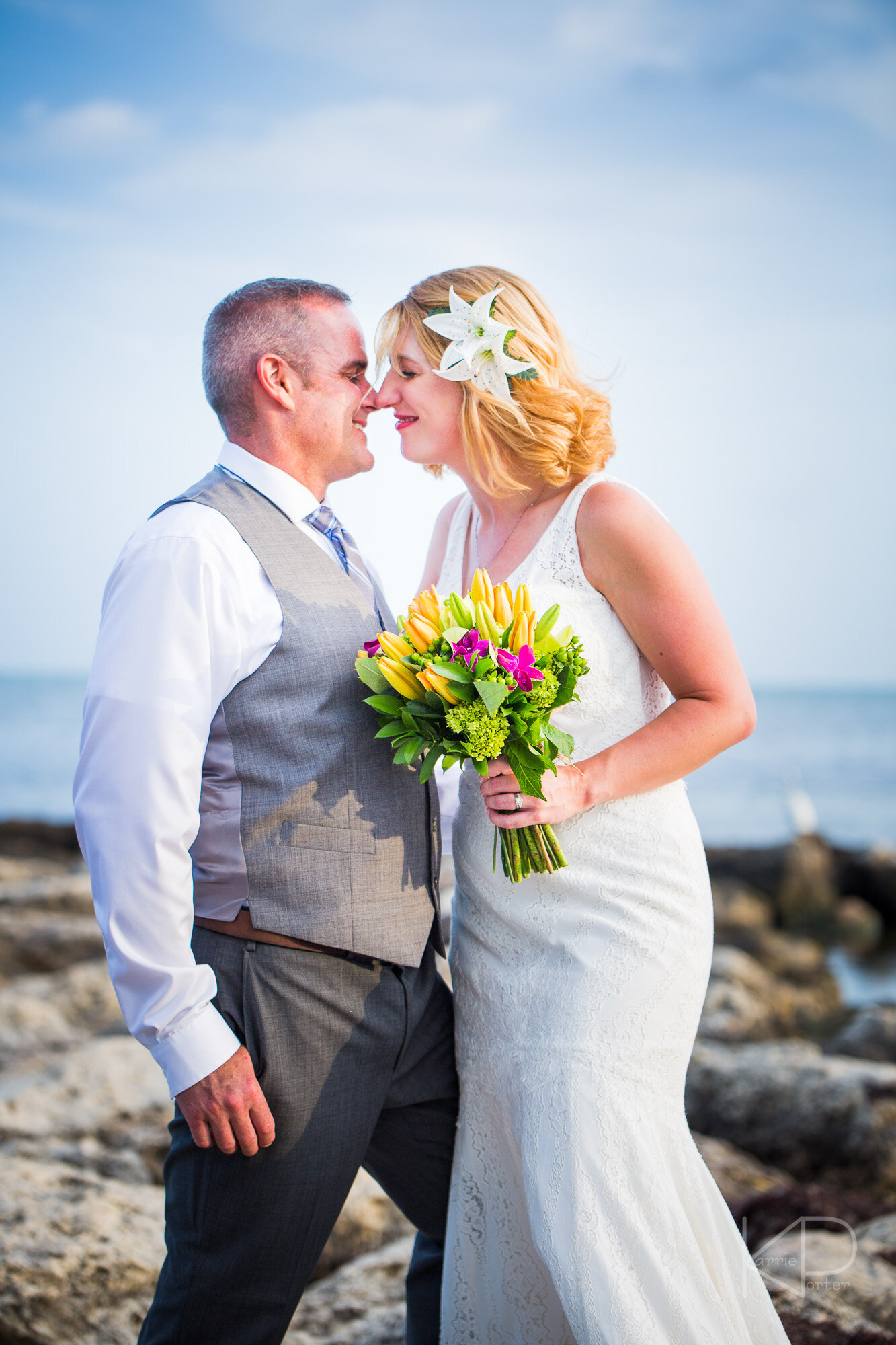 Bride and groom smiling on the beach of Key West